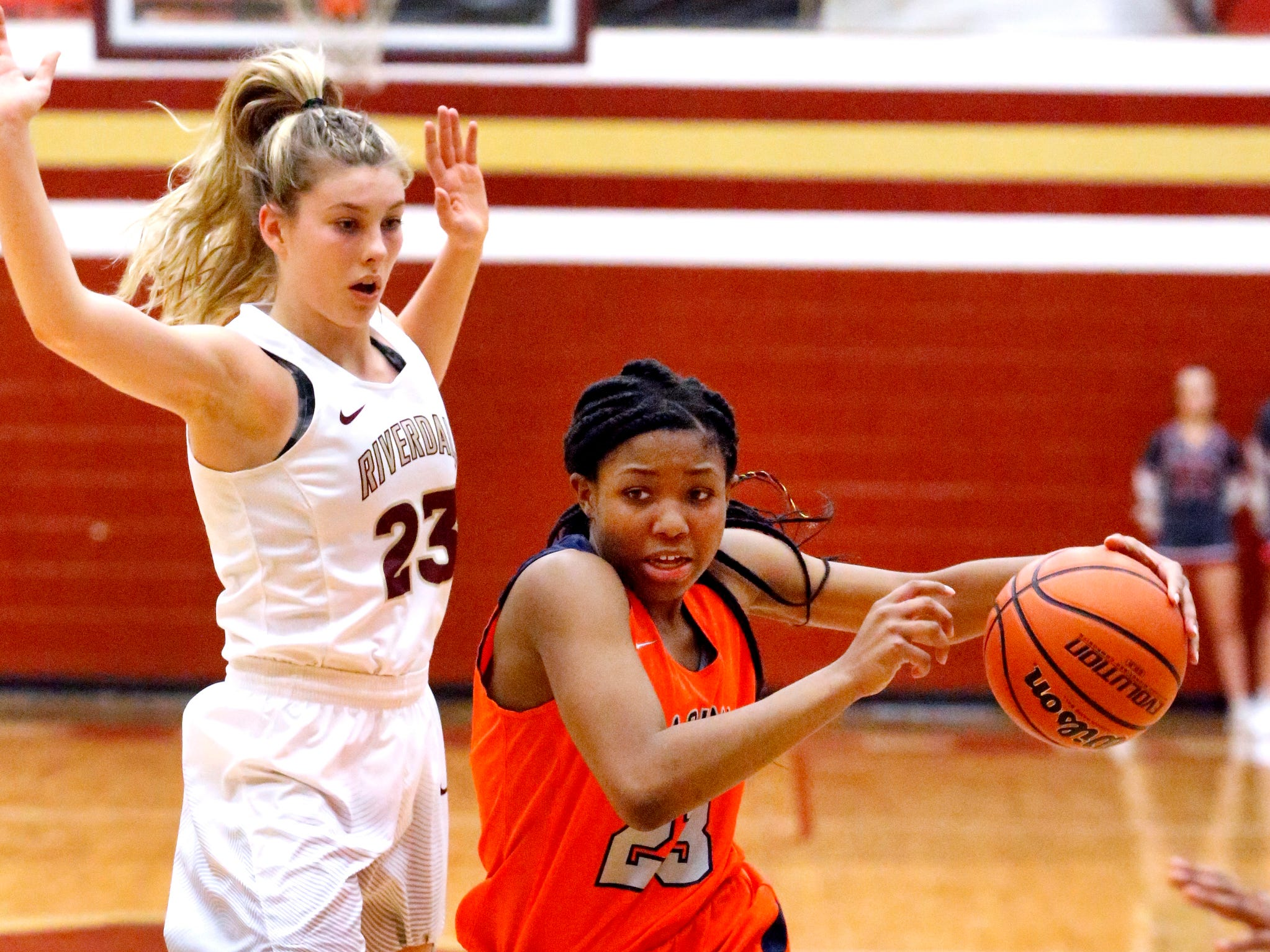 Blackman's Iyana Moore (23) pushes to the basket as Riverdale's Jalyn Hollcomb (23) guards her on Tuesday Jan. 8, 2019.
