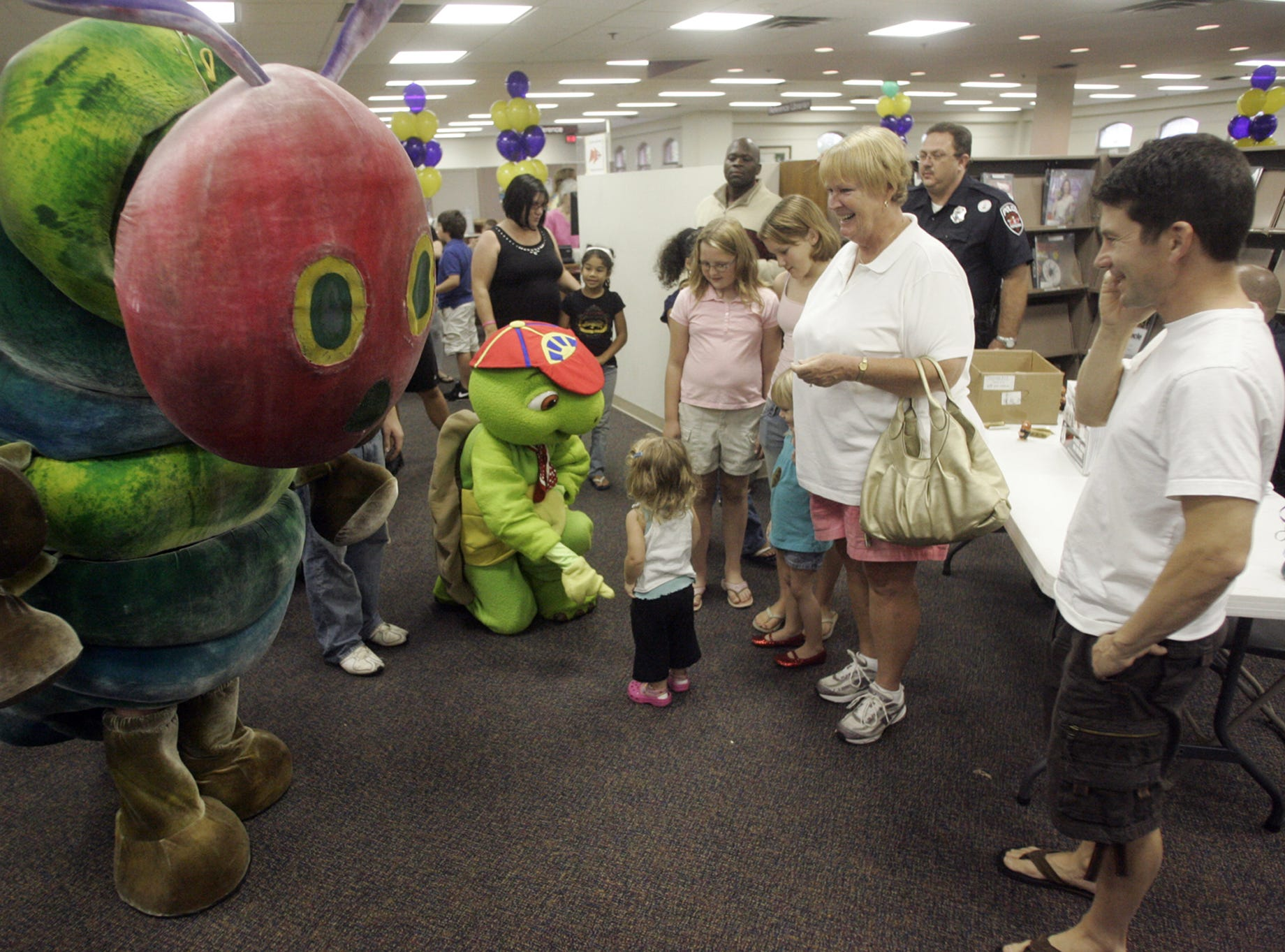 The Very Hungry Caterpillar and Franklin the turtle, both children's book characters, hang out with patrons at Linebaugh Library during a previous Read To Succeed Reading Rally.