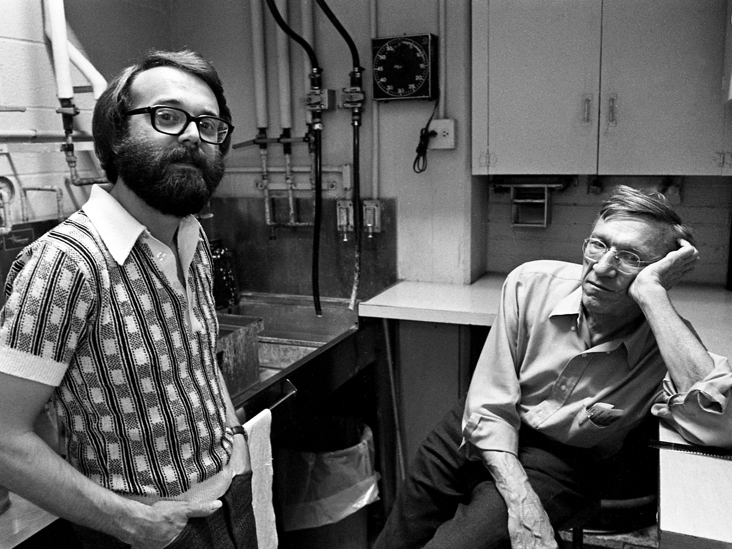 Tennessean photographer Joe Rudis, right, relaxes in the newspaper's darkroom March 18, 1977.