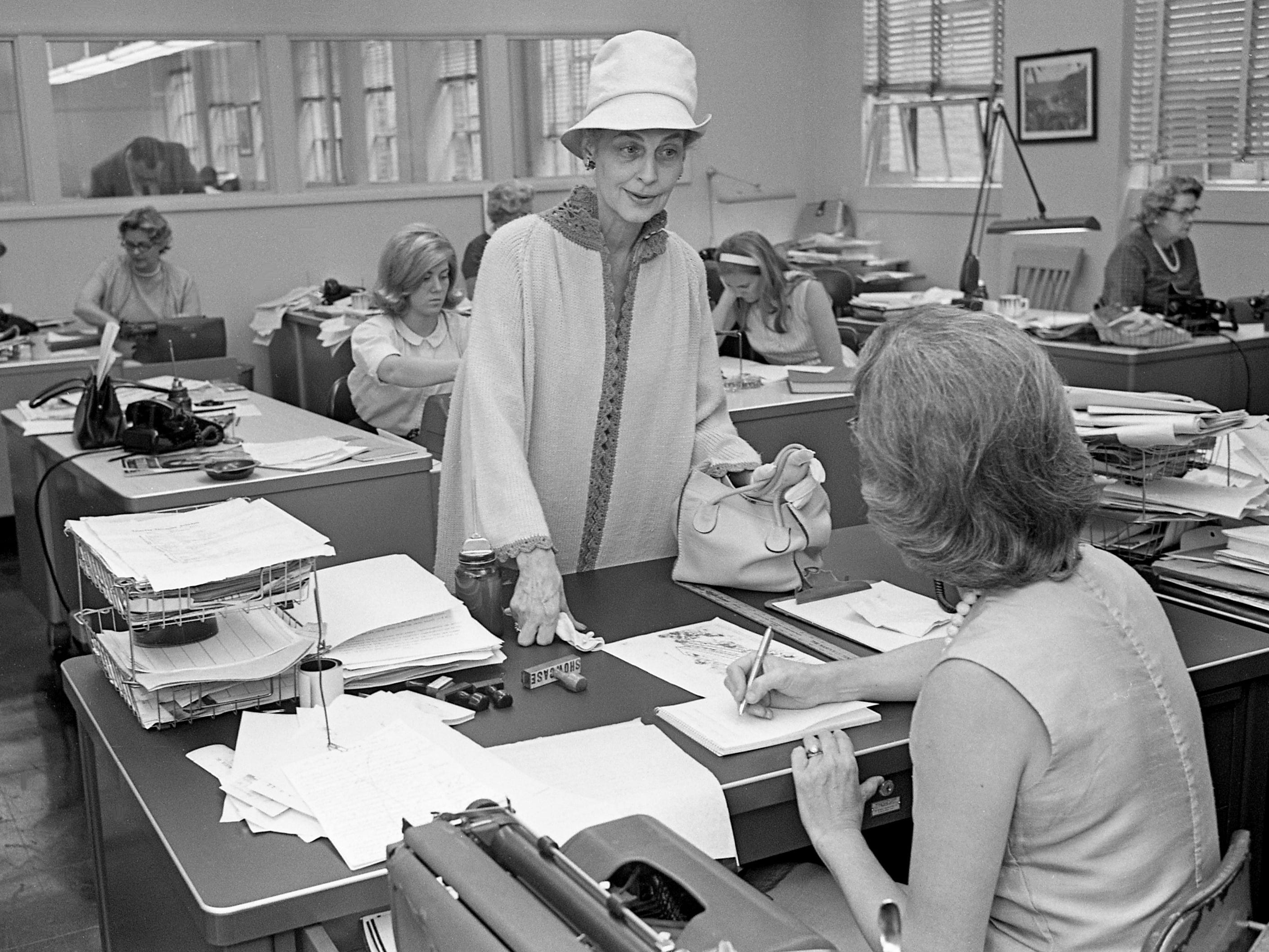 Romola Metzner, center, feature writer and fashion writer for the New York Journal American, visits The Tennessean on June 11, 1965. She was in town to cover the Swan Ball at Cheekwood the next night.