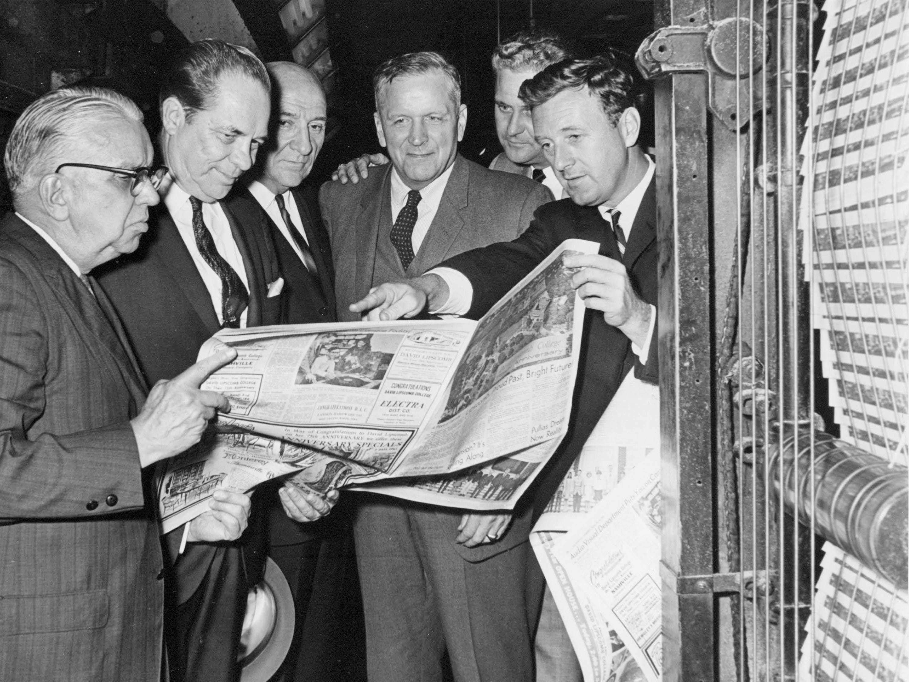 John Seigenthaler, right, editor of The Nashville Tennessean, points out a feature Oct. 8, 1966, in a special section celebrating David Lipscomb College's 75th anniversary. Looking at the first issue to roll off the presses are G. W. Churchill, left, editor of the section; Lipscomb Vice President Willard Collins; Athens Clay Pullias, president of the school; James Armistead, vice president and advertising director of Newspaper Printing Corp.; and Pete Wright, assistant advertising director.