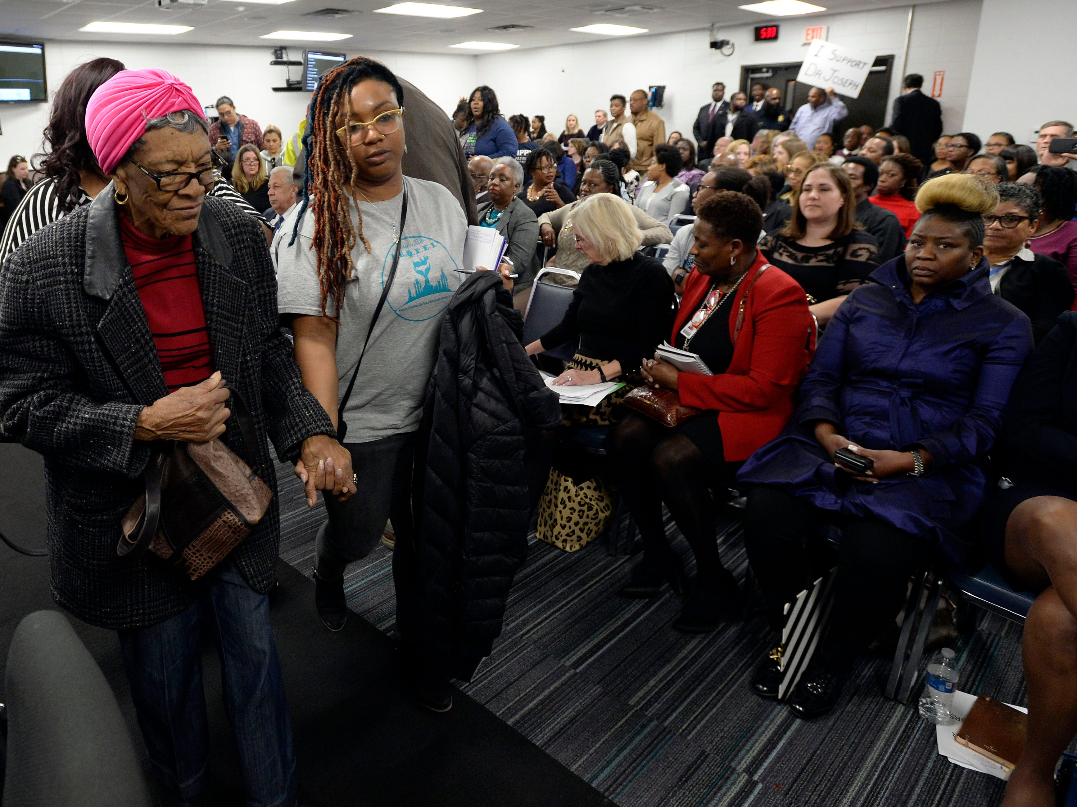 Parents walk out of the Metropolitan Nashville Public Board of Education board meeting on Tuesday, Jan. 8, 2019, in Nashville, Tenn. Parents became angry when board members did not talk about the quality of education for their children.
