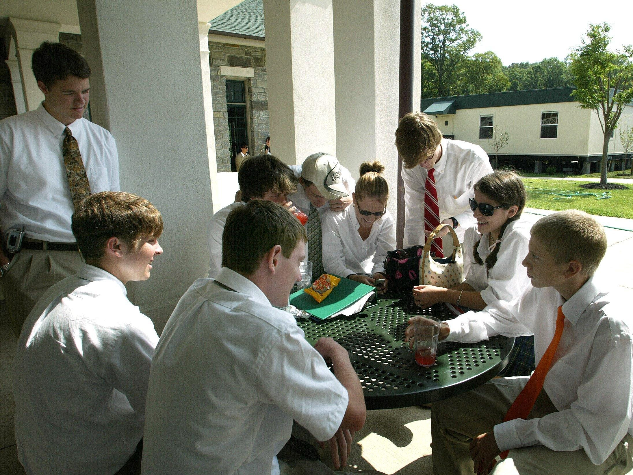 Students at Currey Ingram Academy chat on the patio in between classes in 2004. Behind them are the new temporary classrooms they call the cottages.