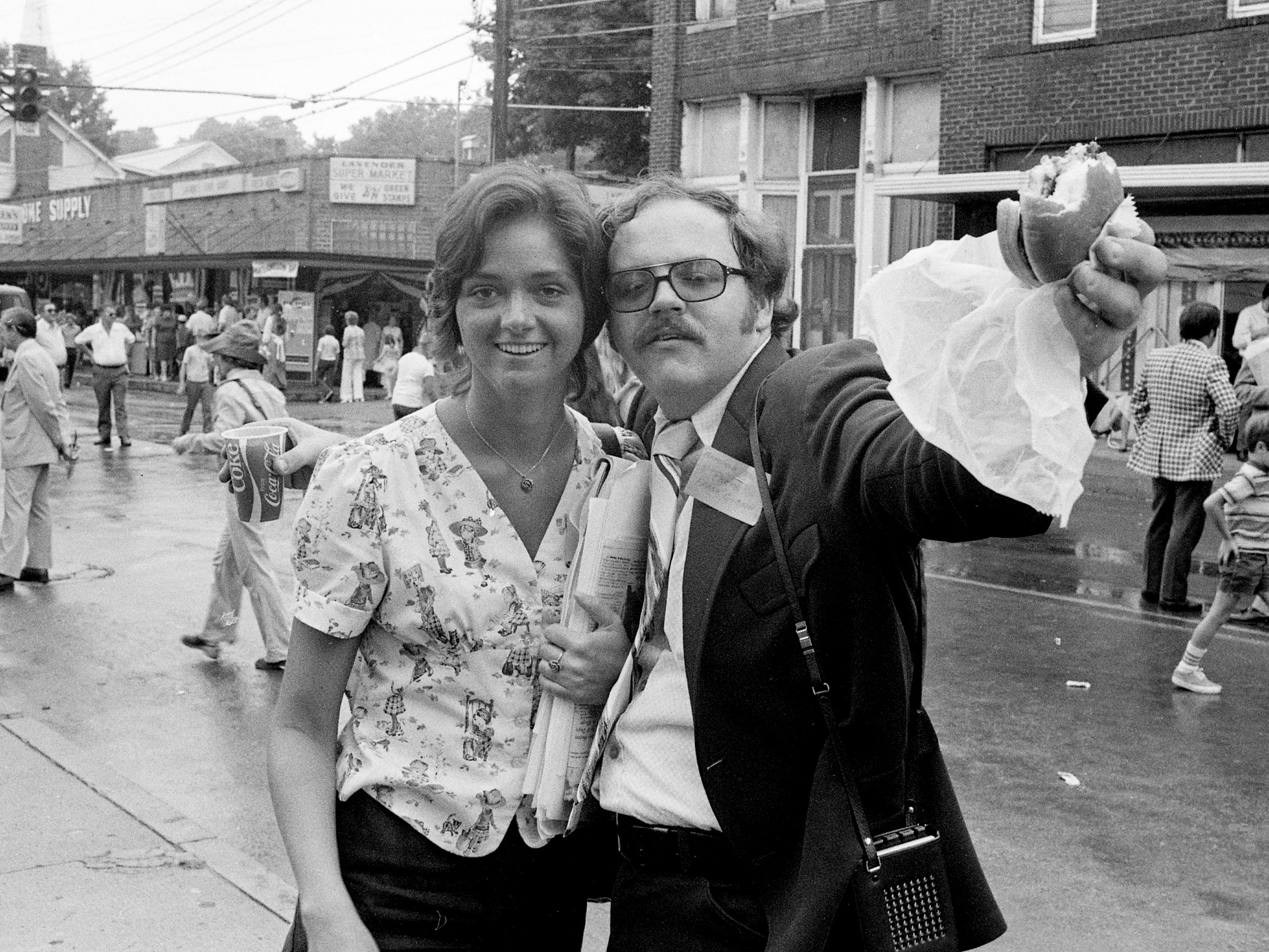 Tennessean reporter Frank Gibson, right, enjoys a meal during the activities of the bicentennial celebration of Jonesboro, Tenn., on July 6, 1974.