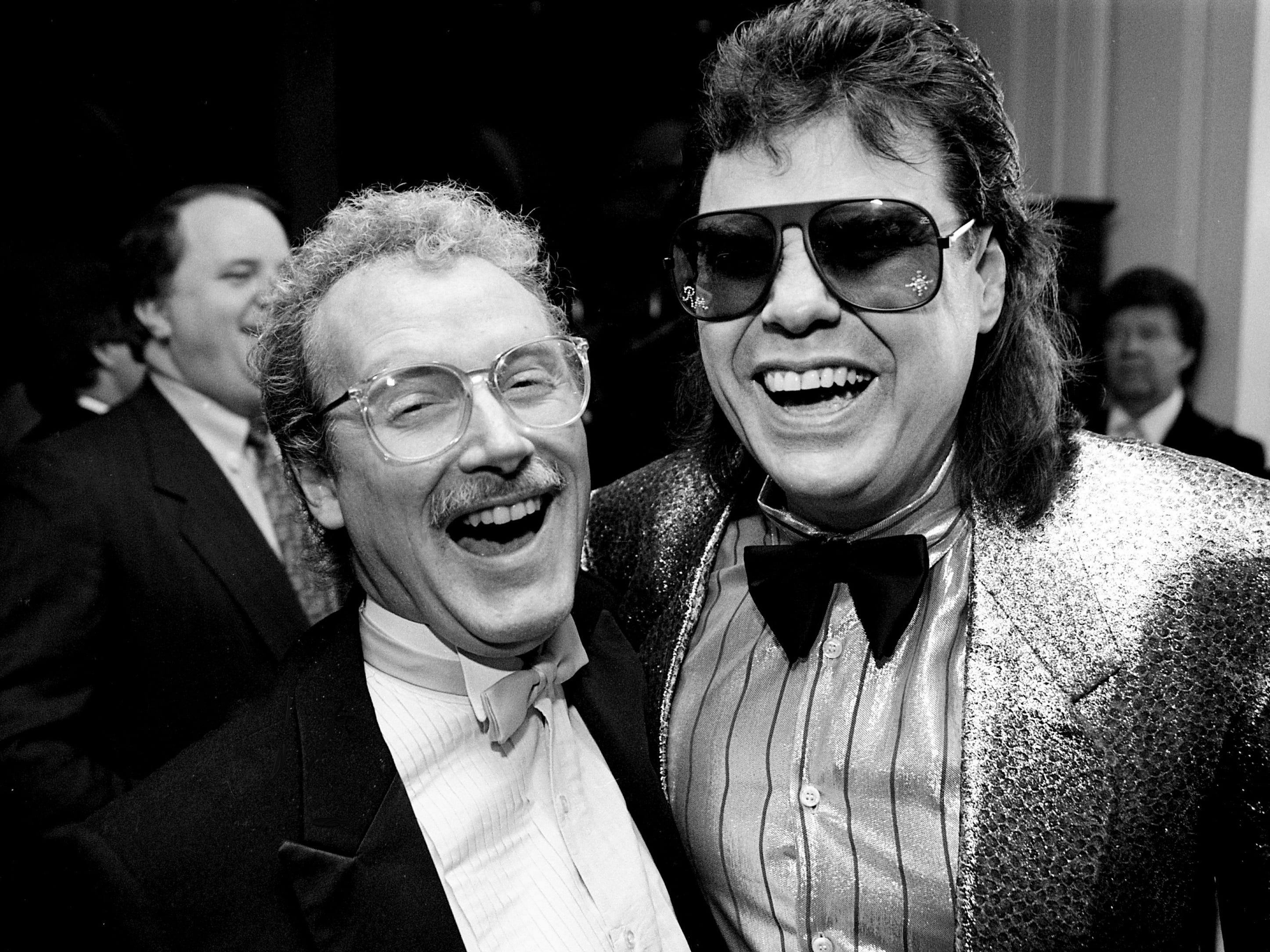 Tennessean music reporter Bob Oermann, left, shares a moment with Ronnie Milsap during the 25th annual ASCAP Country Music Awards ceremony at Opryland Hotel's Presidential Ballroom on Oct. 14, 1987.