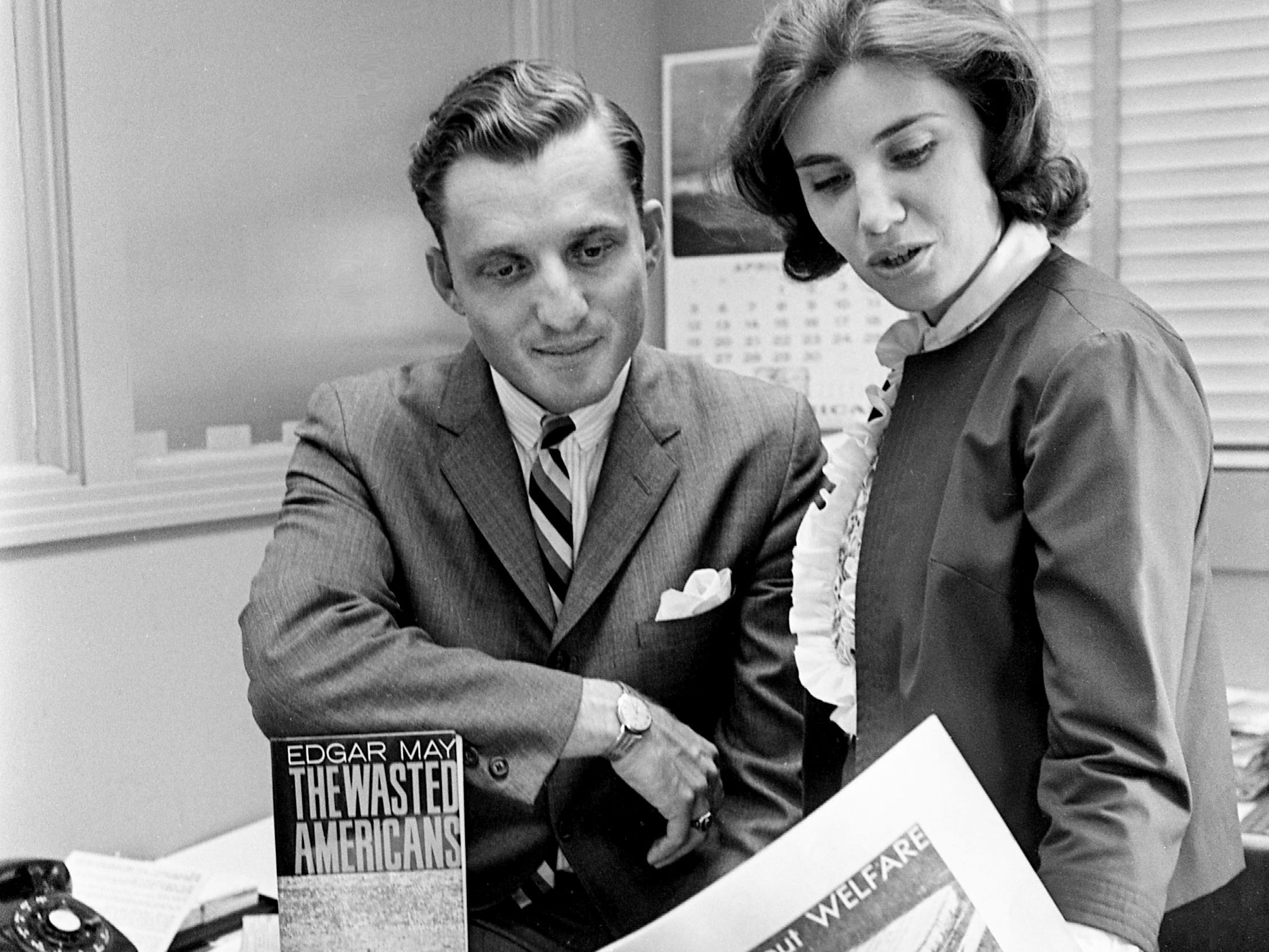 "Edgar May, left, Pulitzer Prize-winning reporter and author, discusses his book, ""The Wasted Americans,"" with Tennessean reporter Julie Hollabaugh as they survey her welfare series, ""The Truth About Welfare,"" after May's address to the Council of Community Agencies on May 6, 1964."