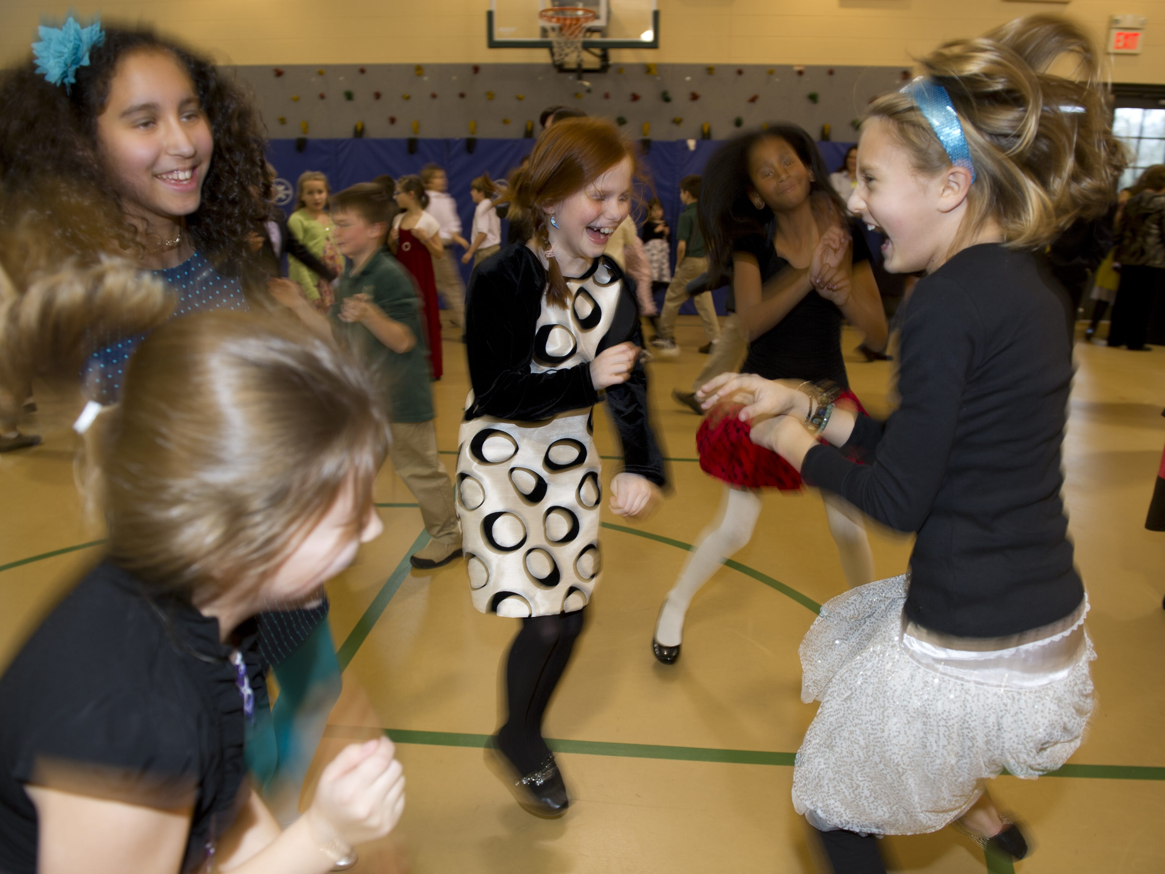 Students dance in the Currey Ingram gymnasium school's Inaugural Ball that celebrated the second inauguration of President Barack Obama in 2013.