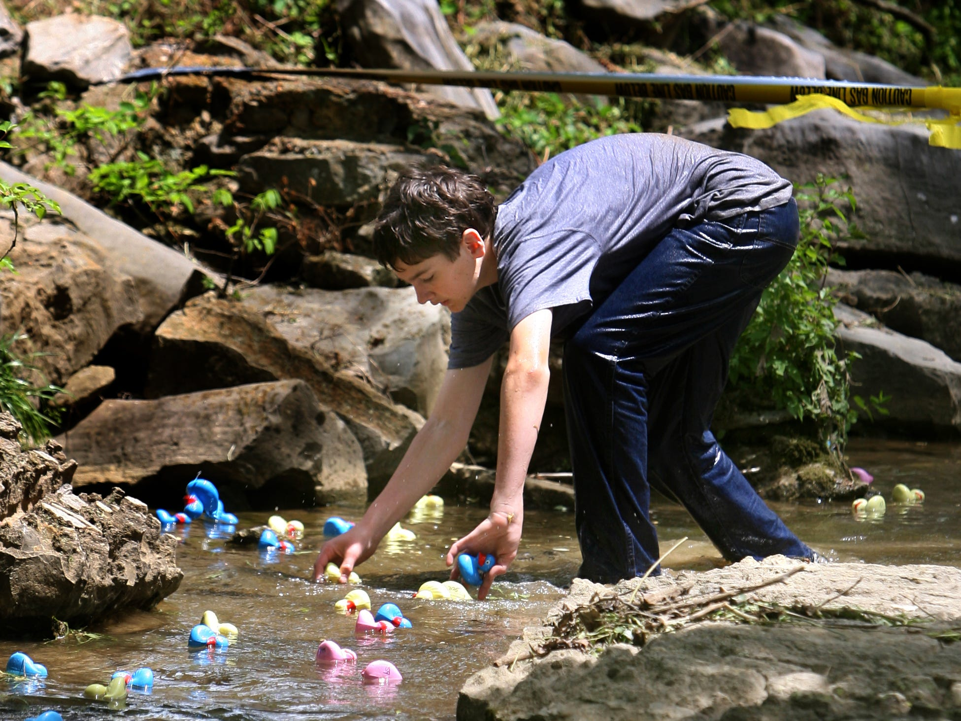 Eighth-grader Sean Conlin keeps the ducks floating down Beech Creek at Currey Ingram Academy on May 7, 2008.