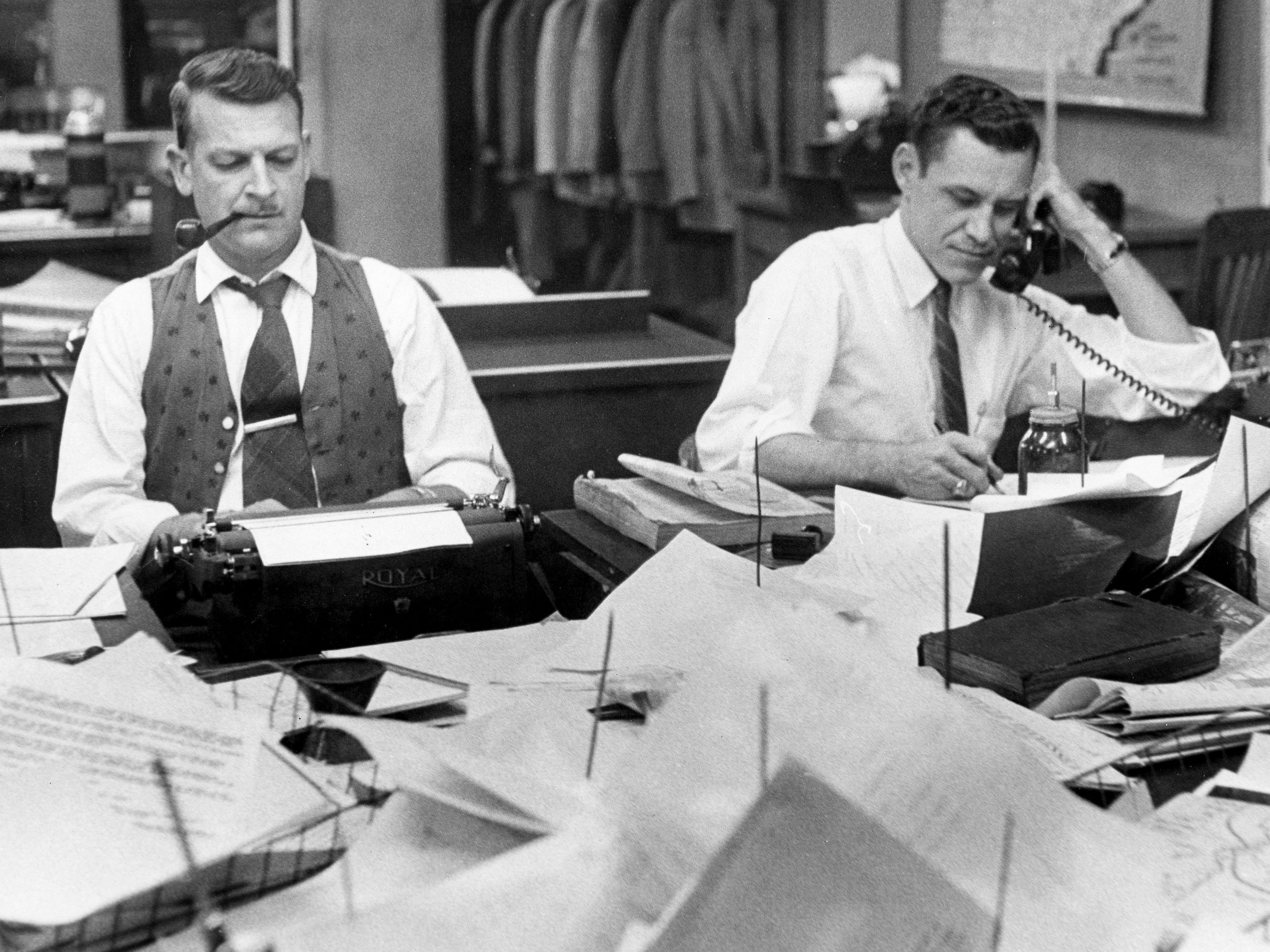Charles L. Fontenay, left, rewriter, and Harold Julian, assistant state editor, work in The Tennessean city room Oct. 21, 1959.