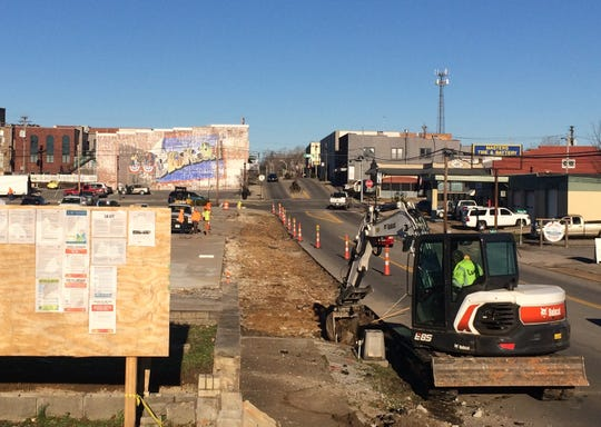 Crews work on Phase 4 of Downtown Dickson Revitalization, which includes new sidewalks on East College Street.