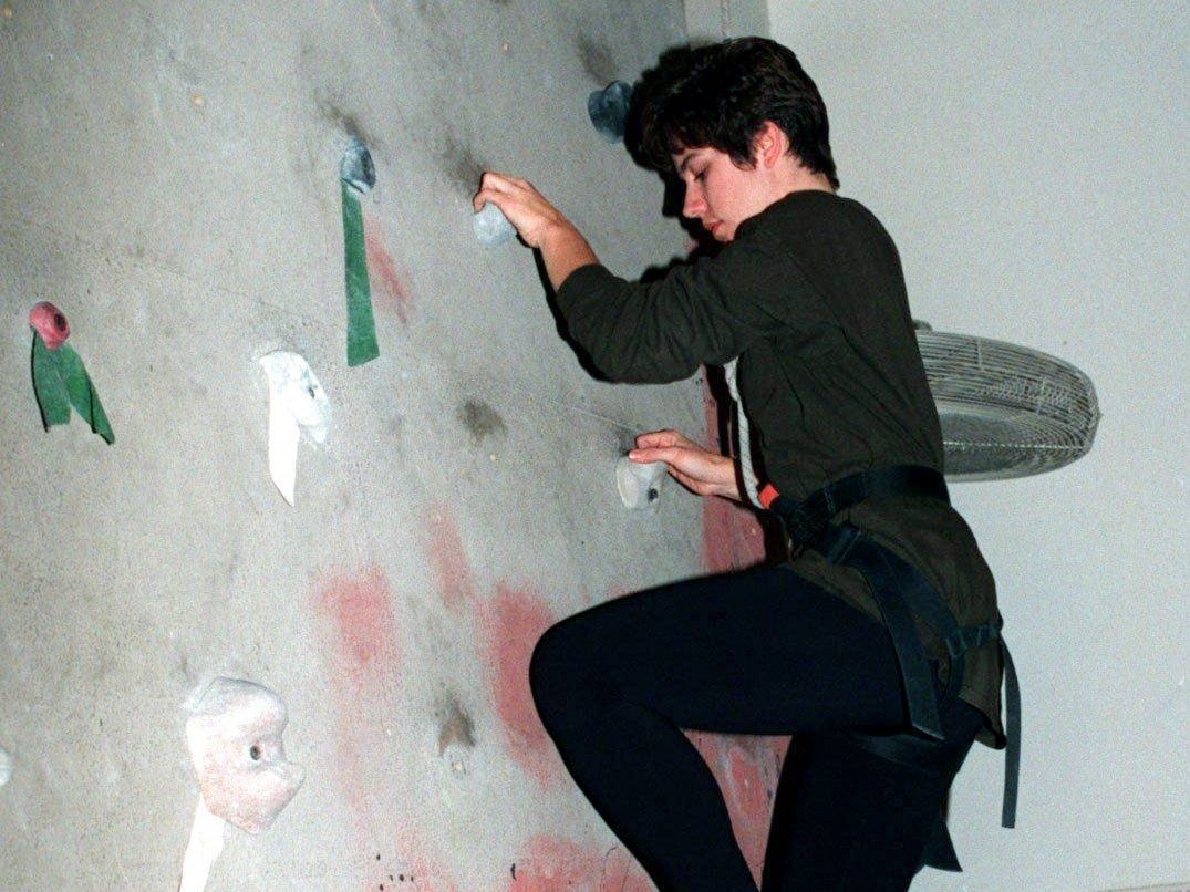Tennessean reporter Fiona Soltes climbs up the rock wall at Classic Rock Gym for a new first-person exercise column Jan. 22, 1997.