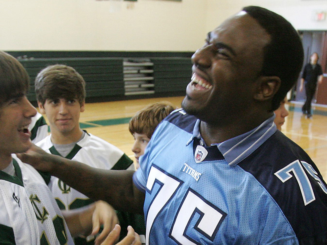 Tennessee Titan Jovan Haye shares a laugh with Jonathan Phillips, left, after he spoke to students at Currey Ingram Academy in Brentwood to share his own story about dealing with a learning disability on Tuesday, Sept. 29, 2009.