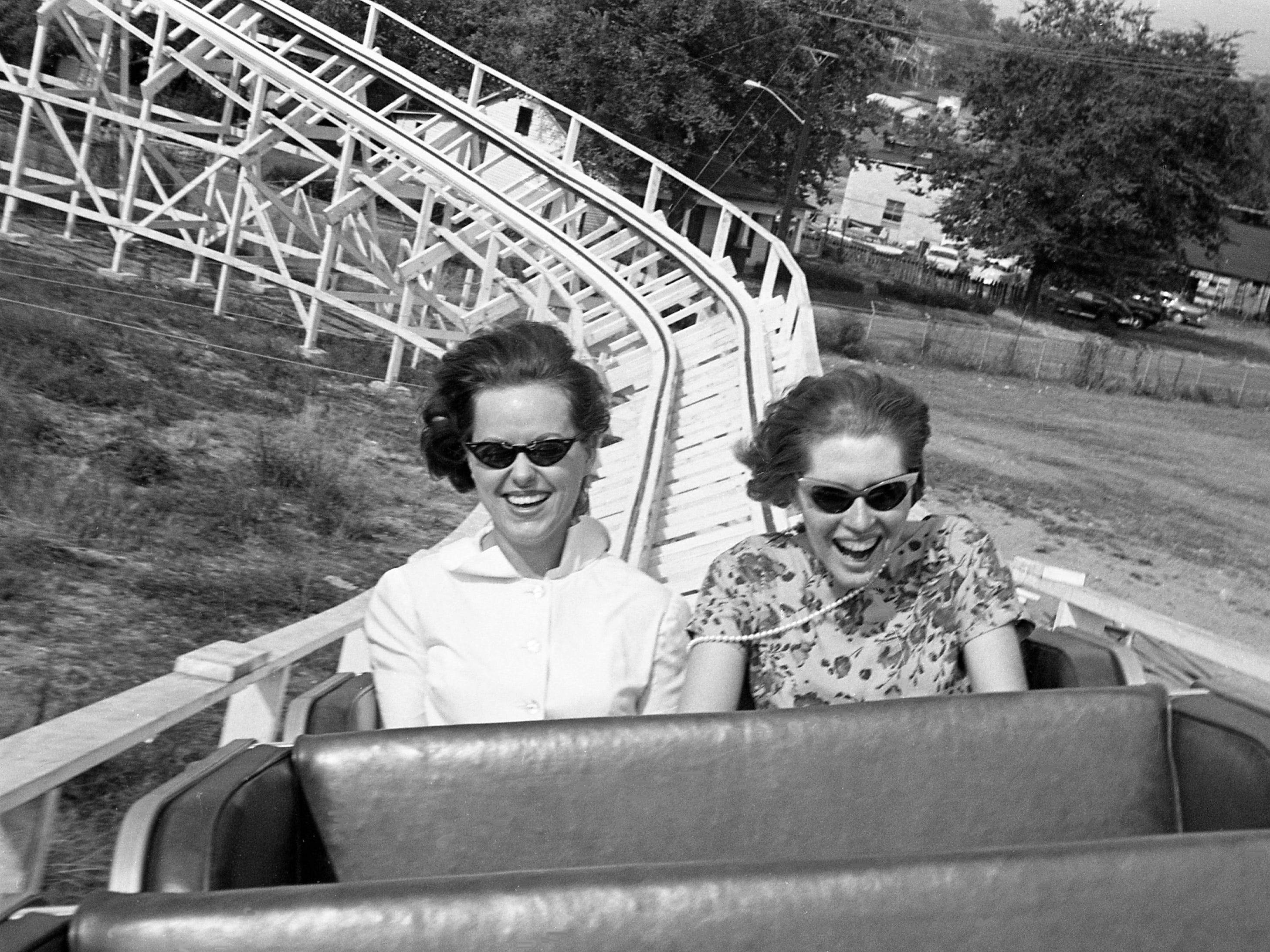The deceptive second hill of the Skyliner, the new roller coaster at the Tennessee State Fairgrounds, takes your breath away, but somehow Alice Sloan, left, and Nancy Bradford find air enough to laugh and scream Aug. 5, 1965. Bradford, a Tennessean reporter, and Sloan, a Tennessean editorial secretary, are test riding the coaster for a story, as it been in operation for about three weeks.