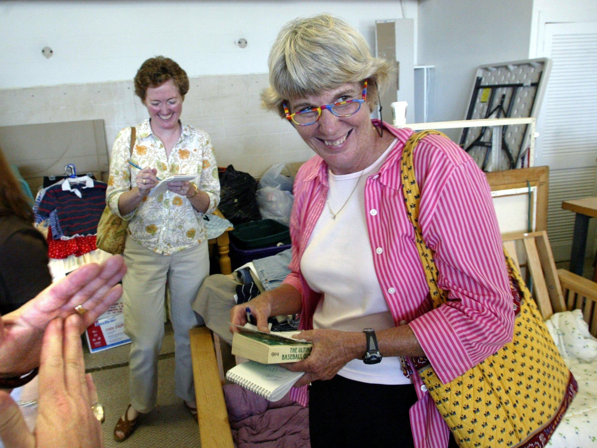 Mary Hance, The Tennessean's Ms. Cheap, right, bargains with an employee at Our Thrift Store in the back room of the store in Spring Hill as reporter Sue McClure takes notes June 22, 2005.
