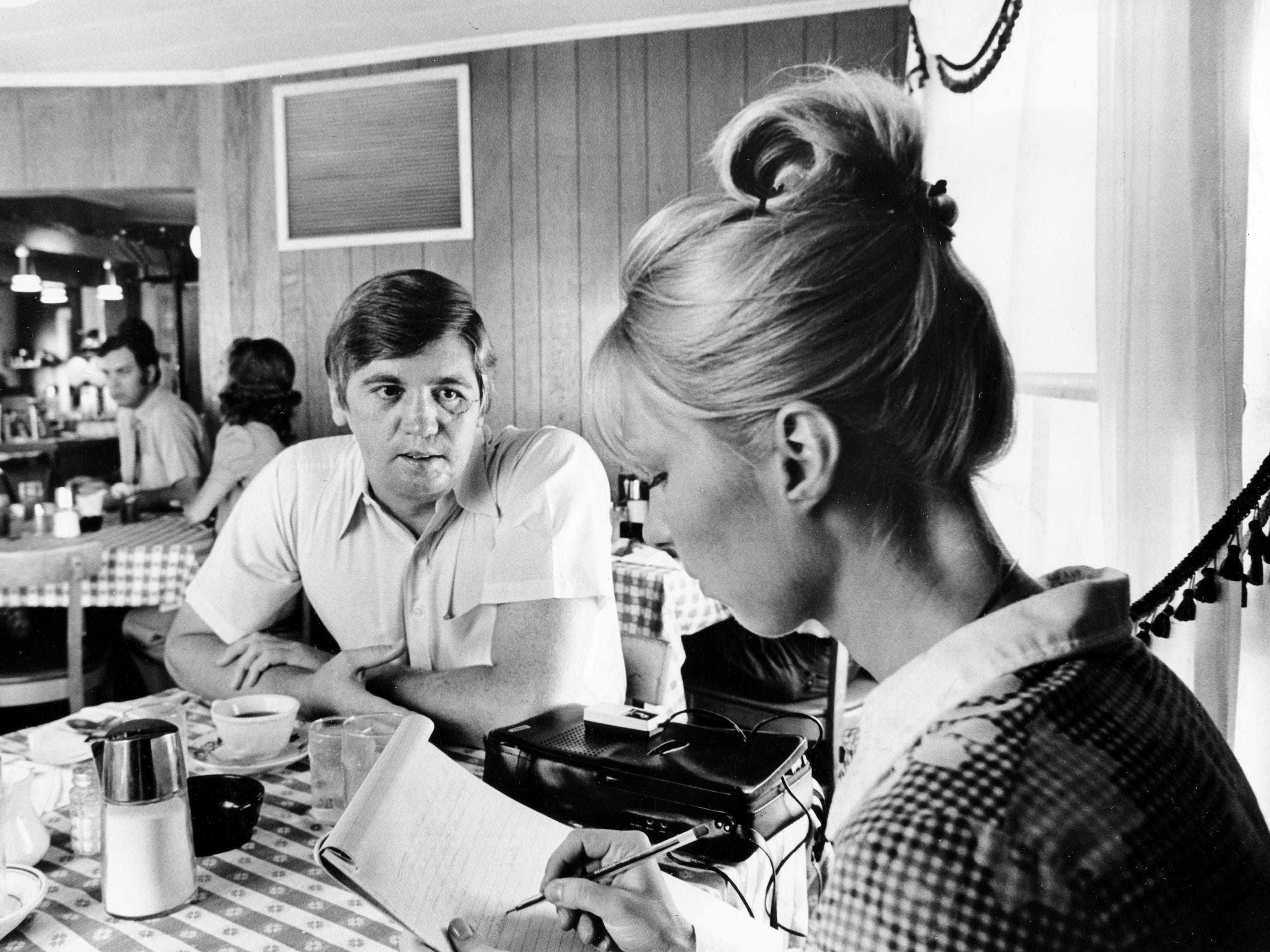 Former McNairy County Sheriff Buford Pusser, center, relaxes at the Old Home Restaurant and Motel in Adamsville, his hometown, on Aug. 1, 1973, as he is interviewed by Kathy Sawyer, a reporter for The Tennessean.