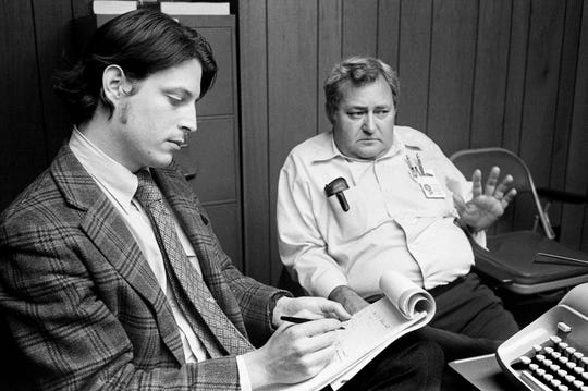 Tennessean reporter Al Gore Jr., left, listens to Nashville lumber salesman Lee Roy Taylor on Feb. 14, 1974. Taylor alleged Metro Councilman Richard Adams asked him to employ his father, William S. Adams, as a real estate broker at cost of $3,000 for introducing a rezoning ordinance for him.
