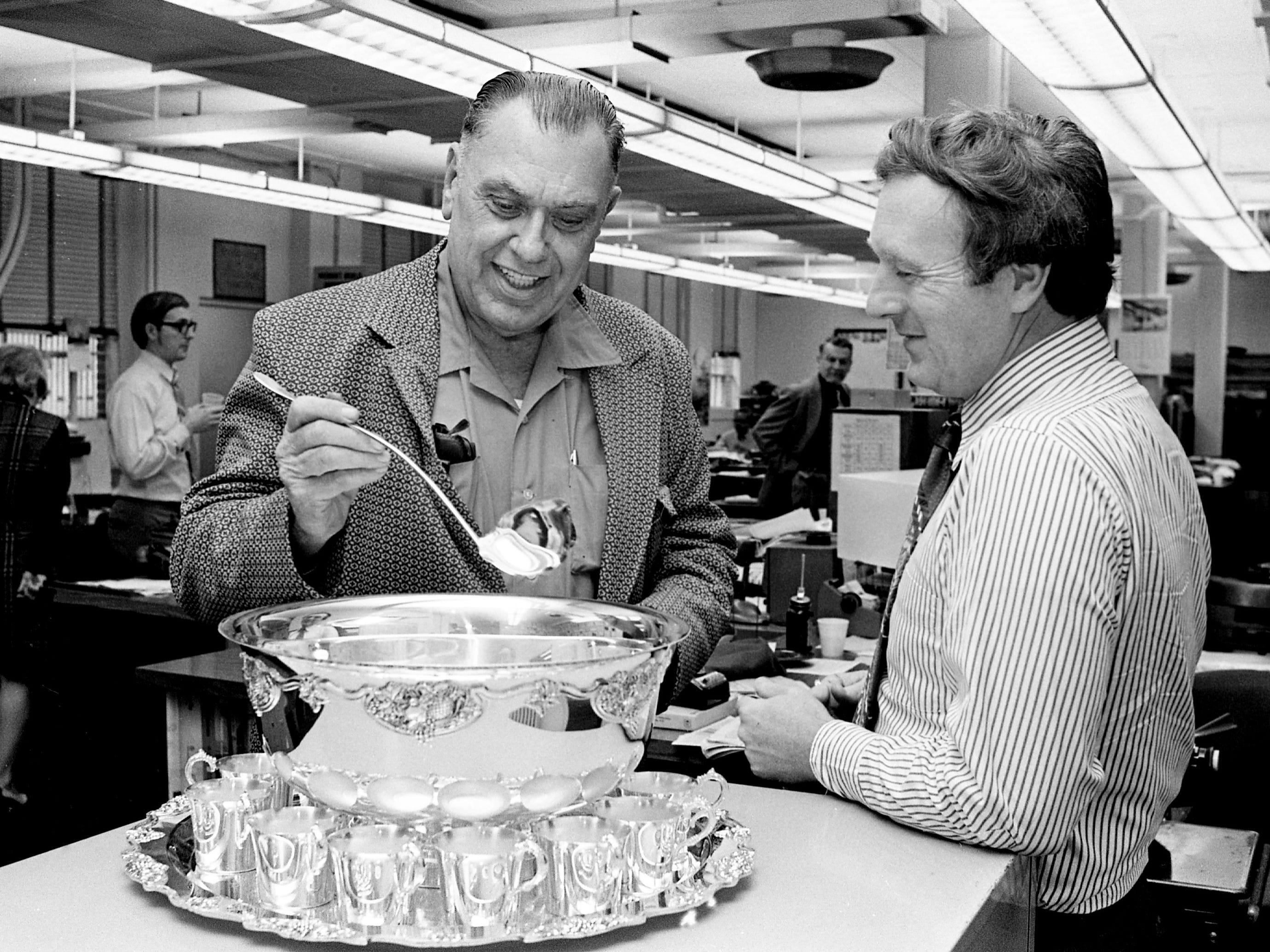 "The sterling silver ladle of a highfalutin's punch bowl set will come ""down to earth"" when used by Elmer Hinton, left, retired columnist for The Tennessean. ""It's just what I need to dip gravy,"" quipped Hinton to John Seigenthaler, editor of The Tennessean. Seigenthaler presented the punch service to Hinton following his retirement Jan. 2, 1973, after 30 years at the newspaper."