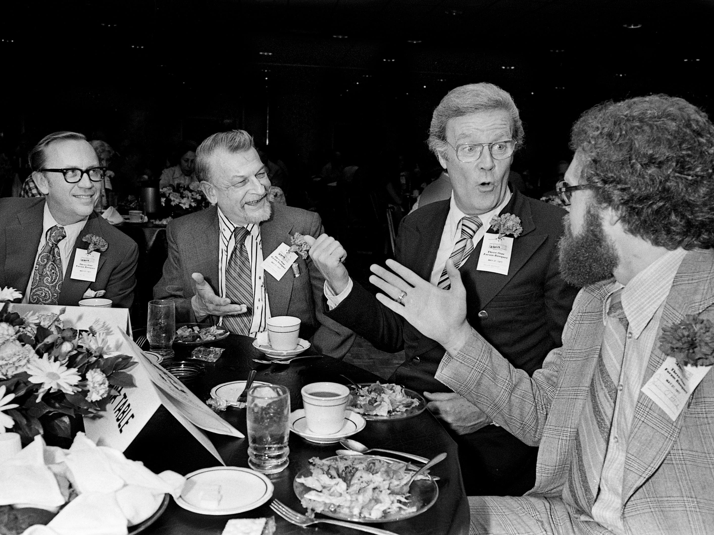 "Wallace Westfeldt of the Washington Post and a former Tennessean reporter, second from right, reminisces about ""the good old days"" with Carl May, left, the promotions director; Charles L. Fontenay, the rewrite man; and Jim O'Hara, editorial writer, during the paper's 38th annual Three-Star Forum Banquet on May 27, 1977."