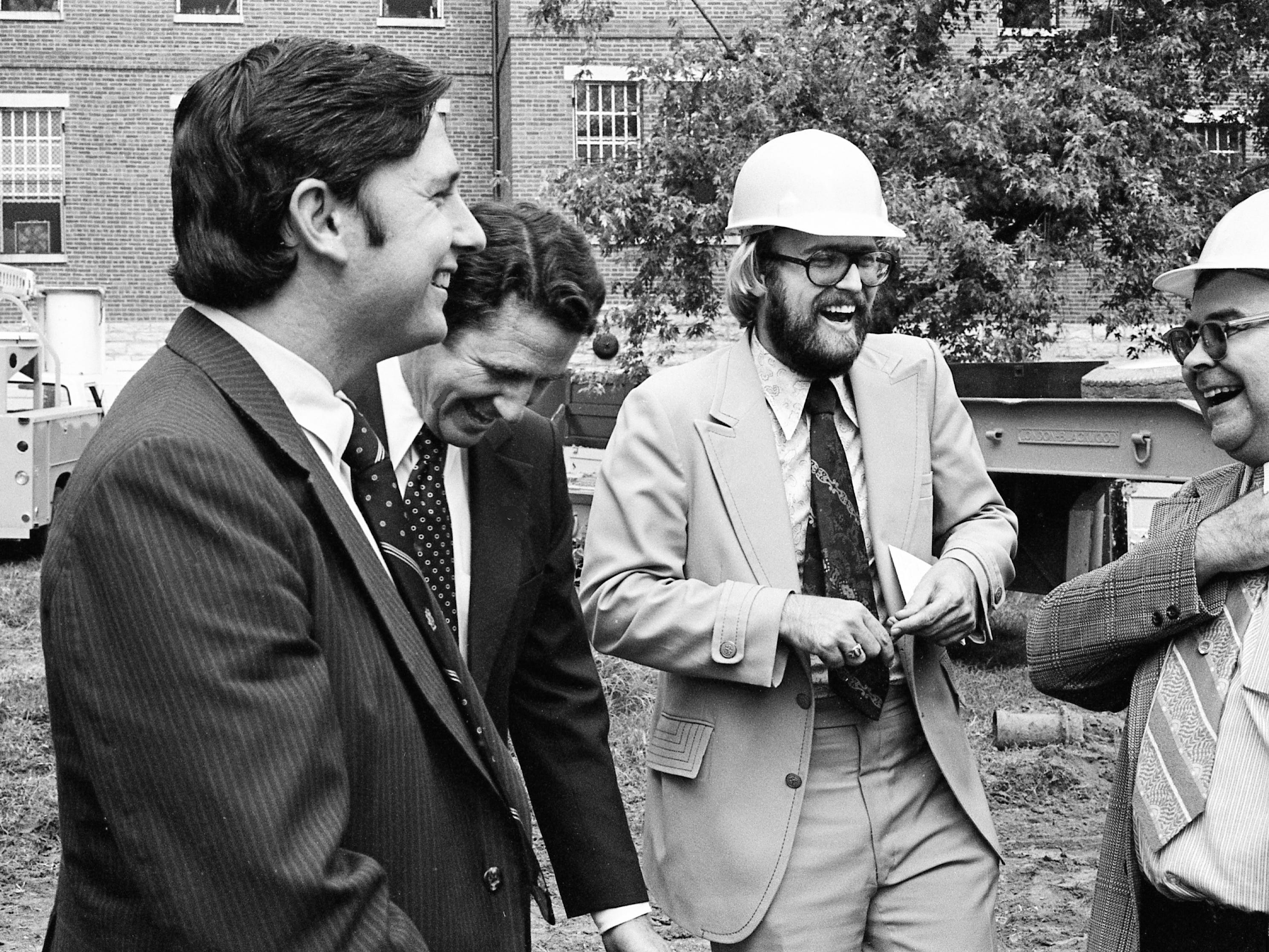 Tennessean reporter Frank Sutherland, second from right, laughs with Gov. Winfield Dunn, center, at a ceremony marking the first phase of the demolition of several wings in the Farmer Complex of the Central State Psychiatric Hospital on Aug. 8, 1974. For 31 days, Sutherland posed as a patient at the hospital to observe conditions firsthand.
