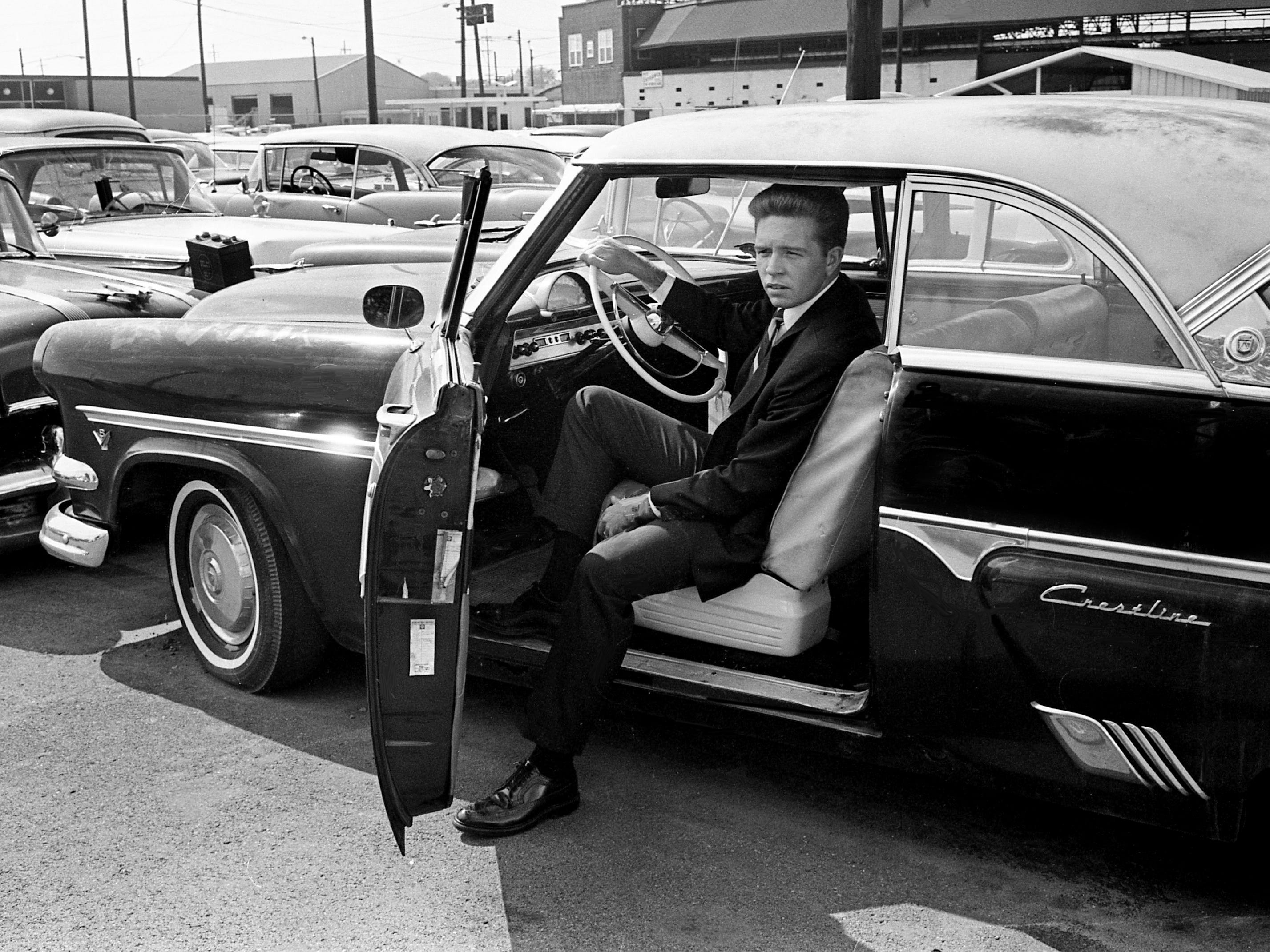 Jim Squires, reporter for The Tennessean, looks over the 1953 Ford he bought for $57 at an auction held by the Metro police department Aug. 10, 1967, at the police department tow-in lot.