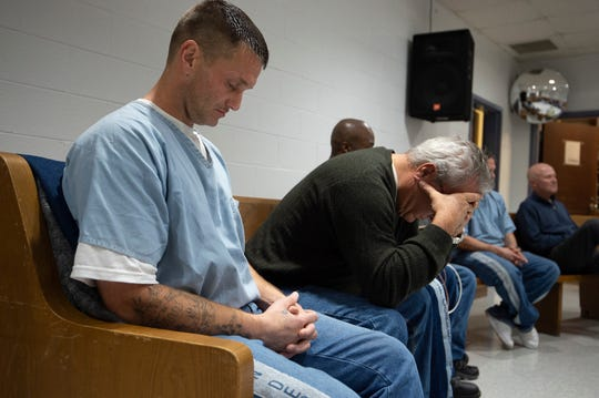 Prisoner Bobby Sanders prayer during a Men of Valor bible study at the Riverbend Maximum Security Institution Tuesday, Jan. 8, 2019, in Nashville, Tenn.