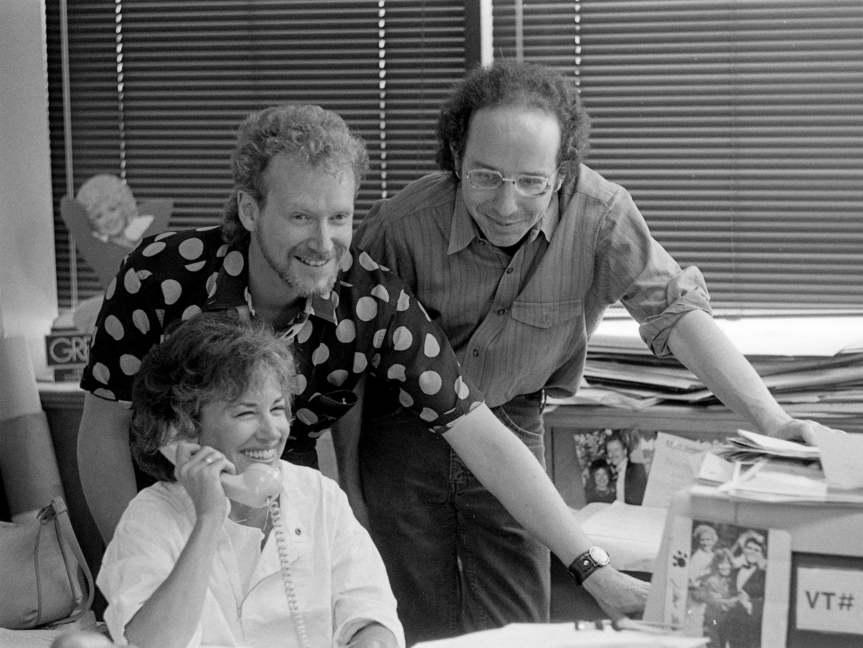Tennessean music reporters Sandy Neese, sitting left, Robert Oermann and Tommy Goldsmith are hard at work in the office at 1100 Broadway on May 4, 1985.
