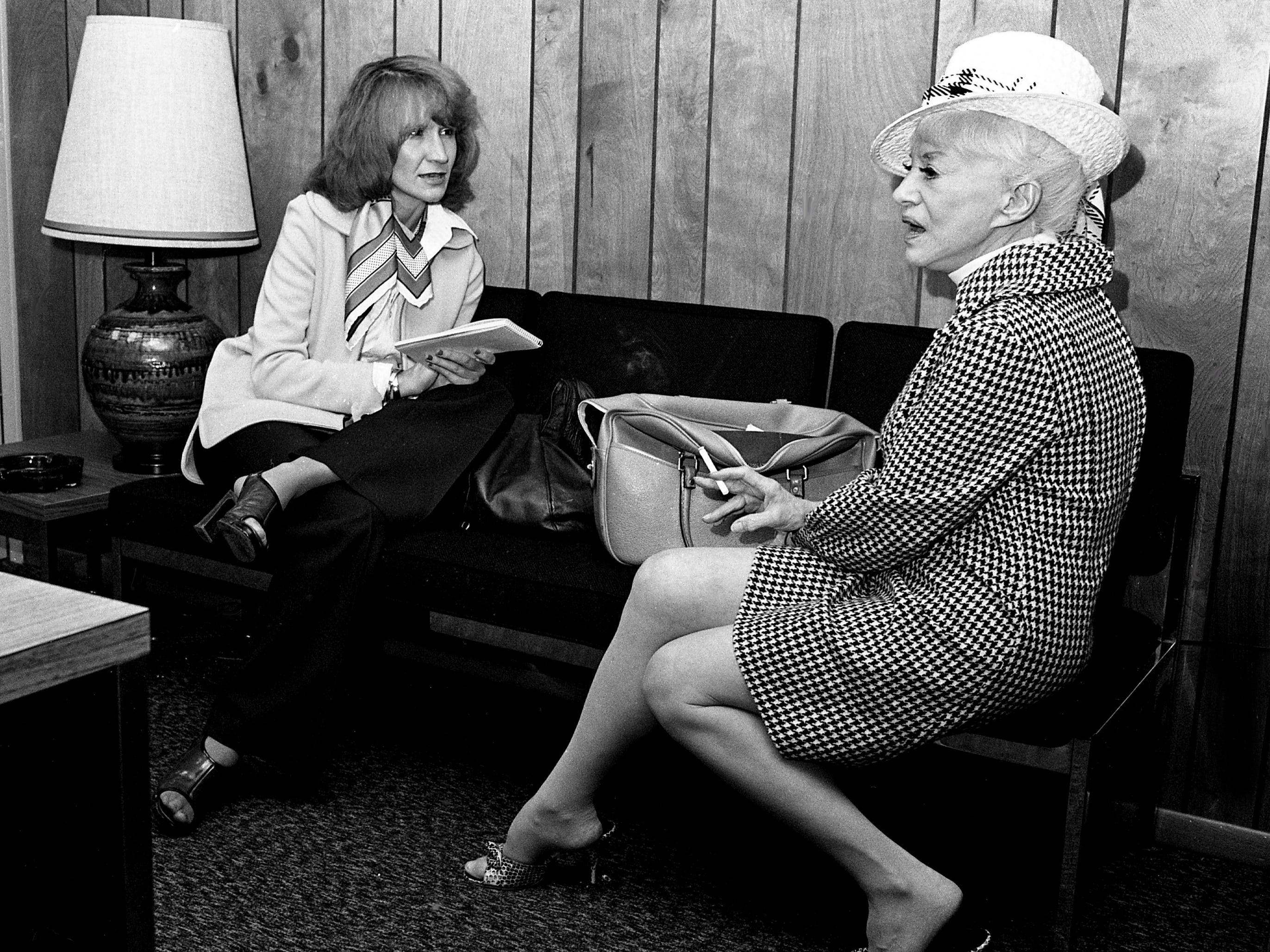 Tennessean reporter Jackie White, left, interviews famed burlesque dancer and actress Sally Rand at the Nashville Municipal Airport on May 1, 1975.