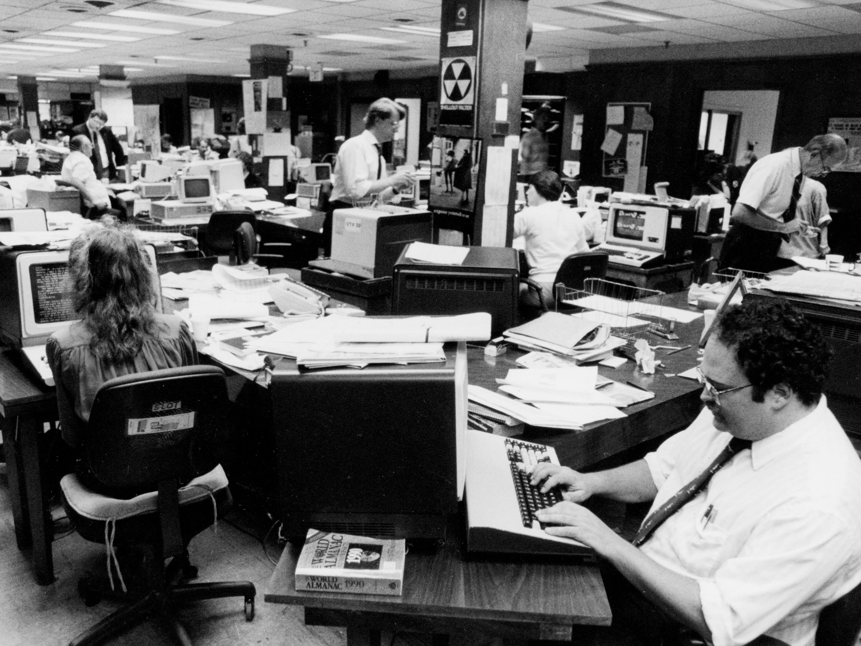 Journalists in The Tennessean newsroom work on deadline in 1990.