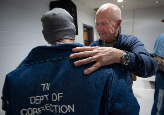 "Rudy Kalis visits with an inmate at the Riverbend Maximum Security Institution. ""I'm trying to be a better man of faith because I'm telling them to do that,"" Kalis said of his time ministering to inmates."