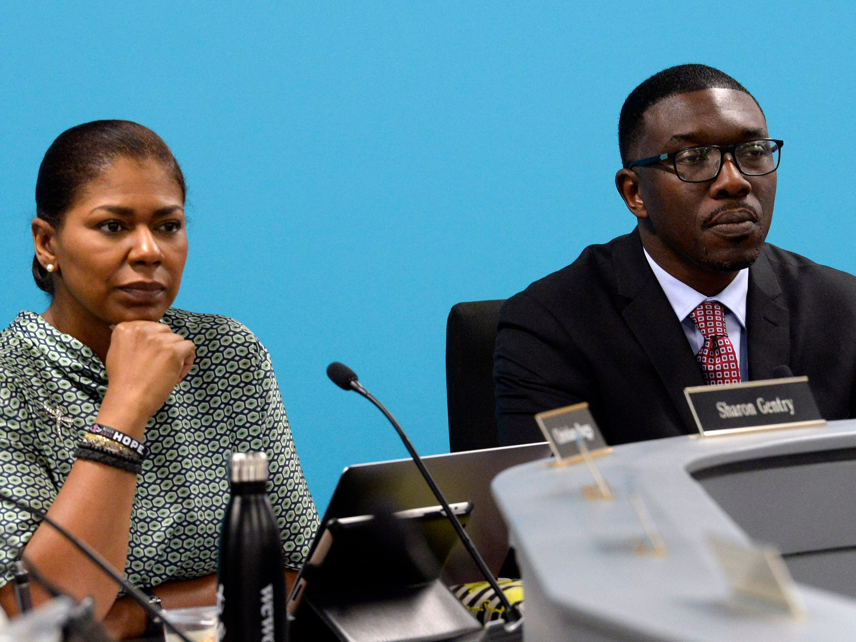 Metropolitan Nashville Public Board of Education board members Sharon Gentry and Nashville Director of Schools Shawn Joseph listen to people speak during a board meeting on Tuesday, Jan. 8, 2019, in Nashville, Tenn. Anger and frustration was shown at the December school board meeting as the district struggles to find $13 million to balance its budget. Some school board members have said they do not trust or have confidence in Shawn Joseph.