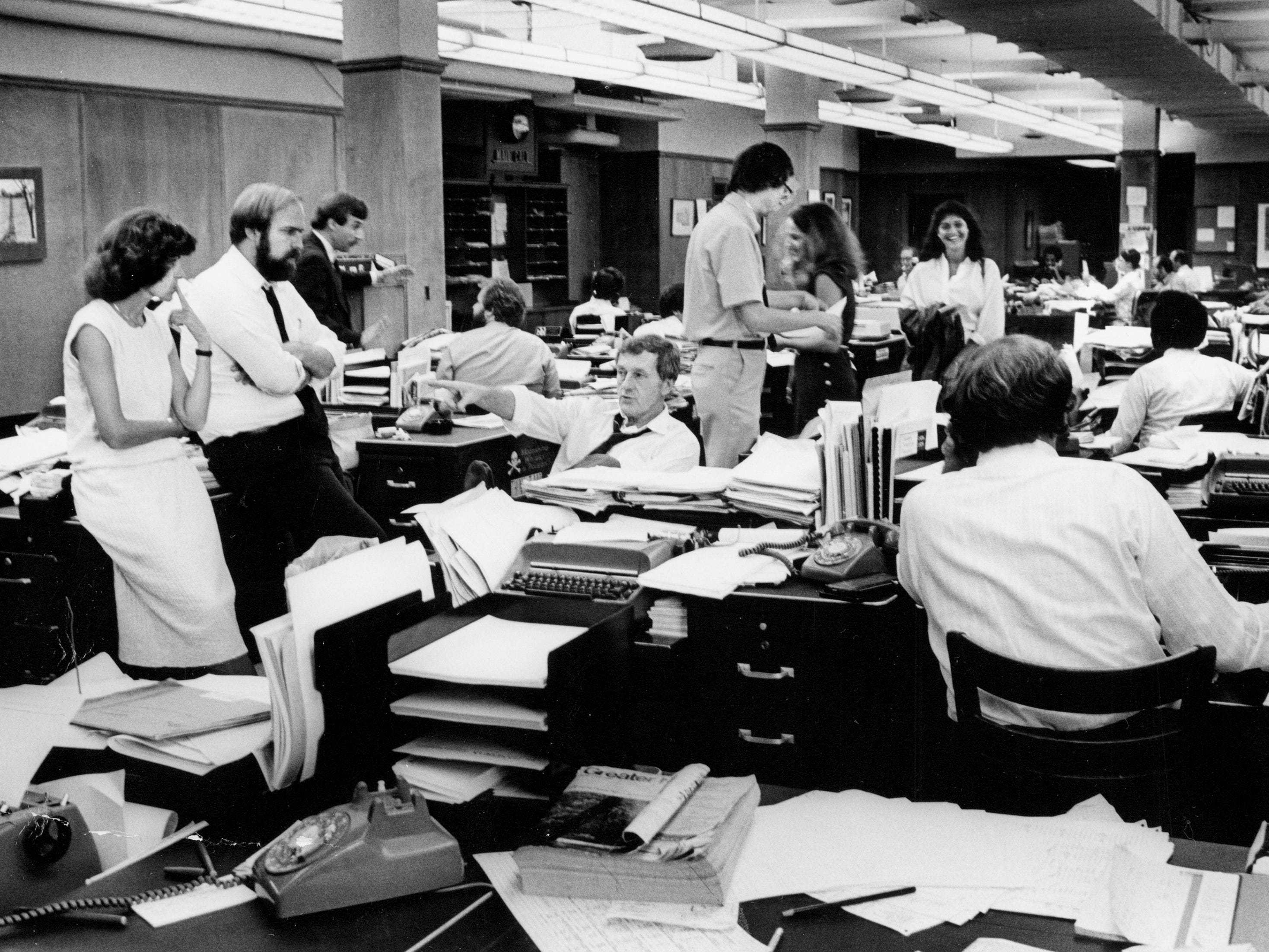 The Tennessean newsroom, with publisher John Seigenthaler, sitting left, works on deadline in October 1979.