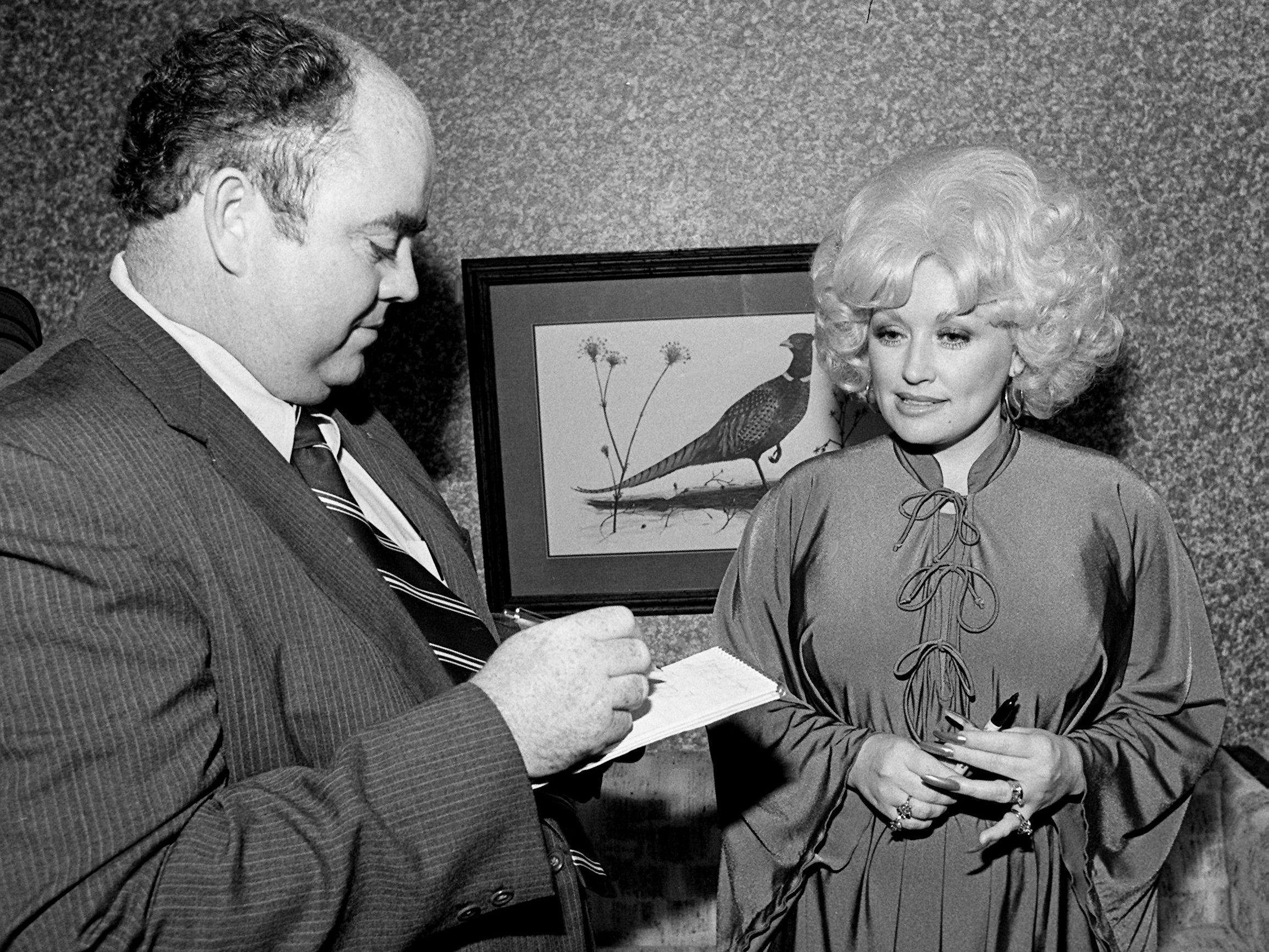 Dolly Parton gets interviewed by  Tennessean reporter Jerry Thompson as she visits the Dollar General headquarters in Scottsville, Ky., on May 1, 1979. Parton was fulfilling a date when she offered her appearance for auction on WDCN's annual Action Auction to support the educational television station.