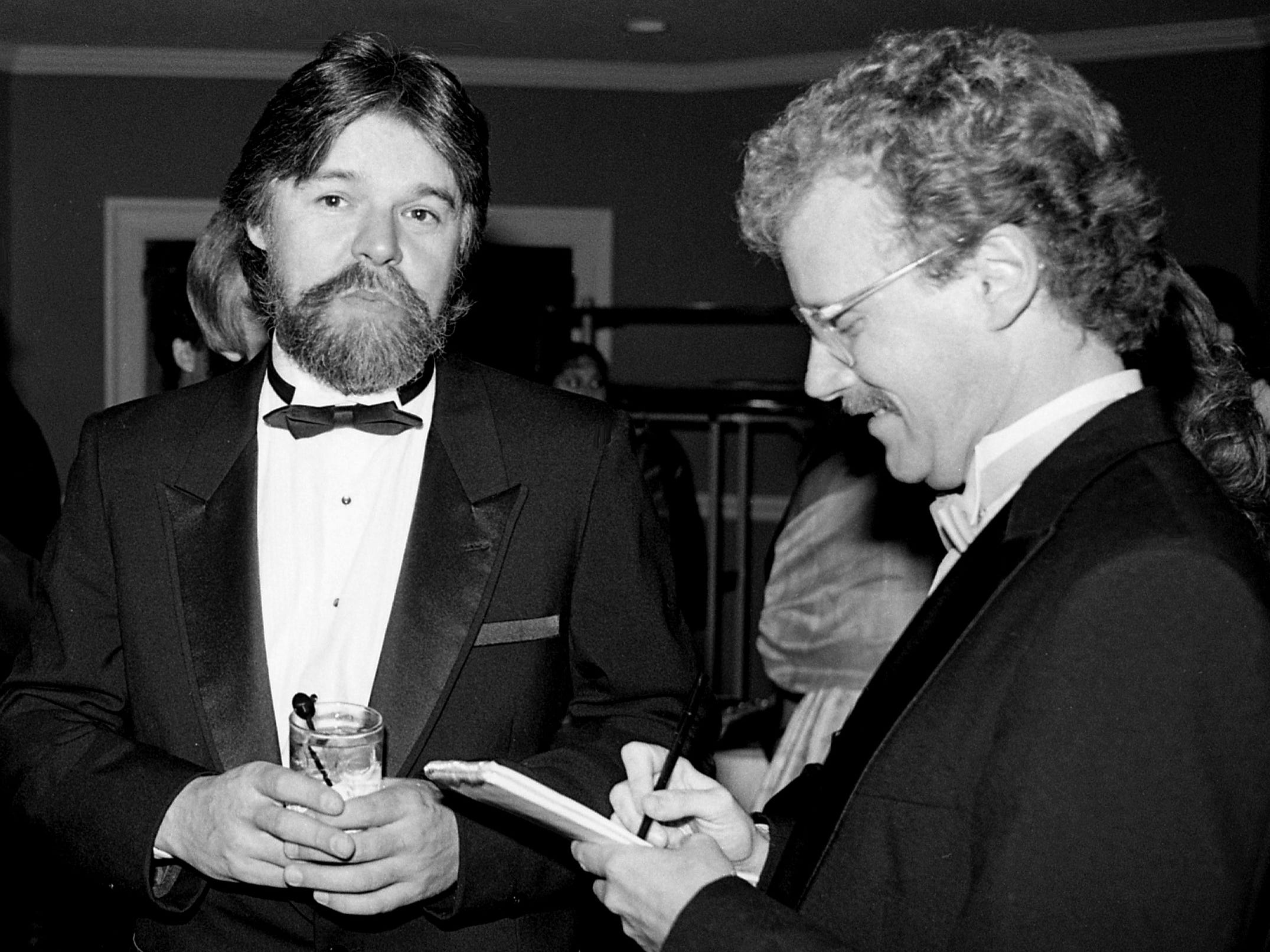 Rock superstar Bob Seger, left, answers questions from Tennessean music reporter Robert K. Oermann during the 22nd annual ASCAP Awards banquet at Opryland Hotel on Oct. 10, 1984.