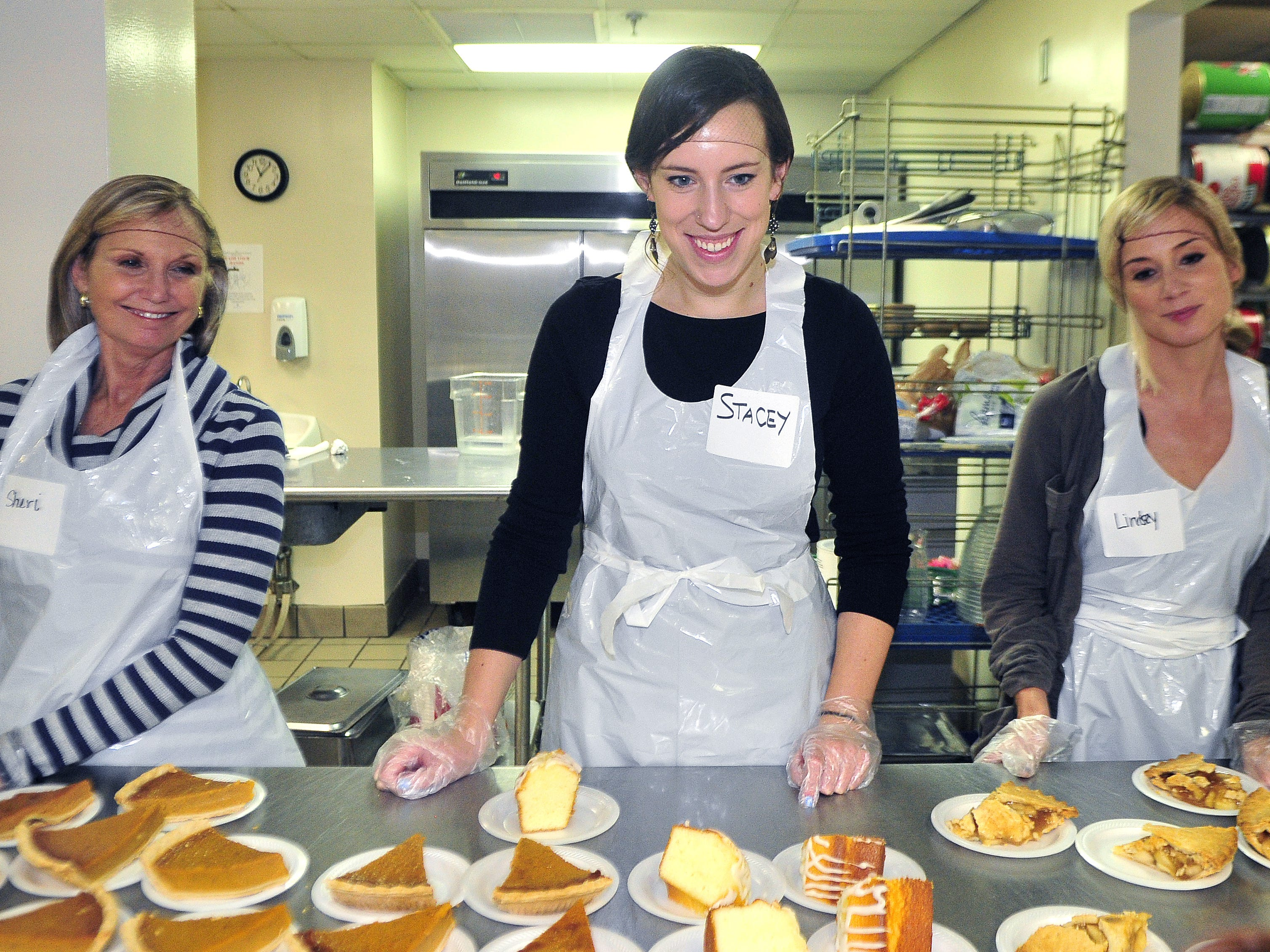 Tennessean reporter Stacey Barchenger, center, helps serve dessert with Sheri Baylor, left, and her daughter Lindsey Baylor at the Salvation Army on Nov. 26, 2015.