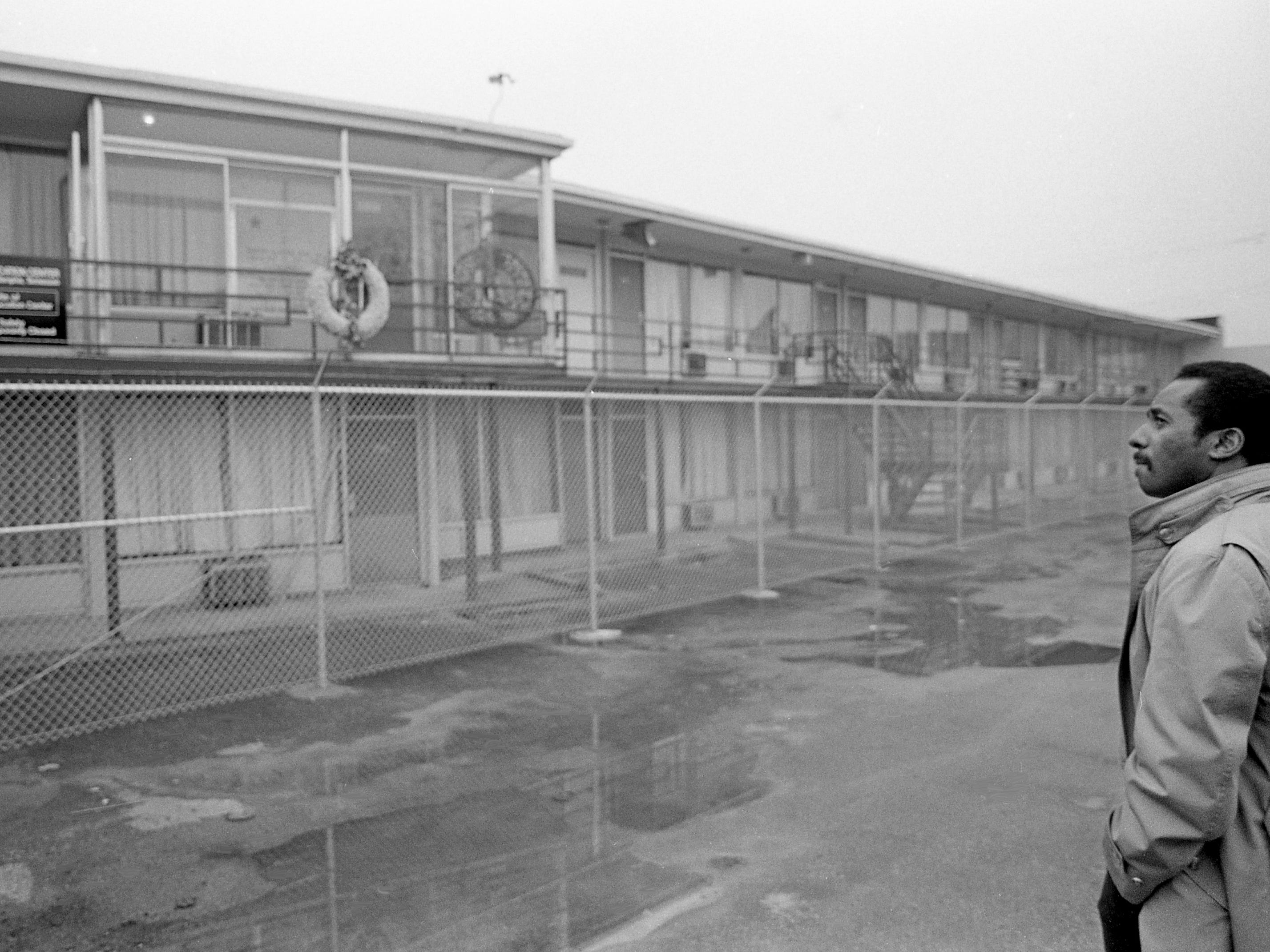 Tennessean reporter Dwight Lewis checks out the closed-off Lorraine Motel in Memphis on Feb. 3, 1988. The site of Martin Luther King Jr.'s assassination on April 4, 1968, will be turned into a civil rights museum.