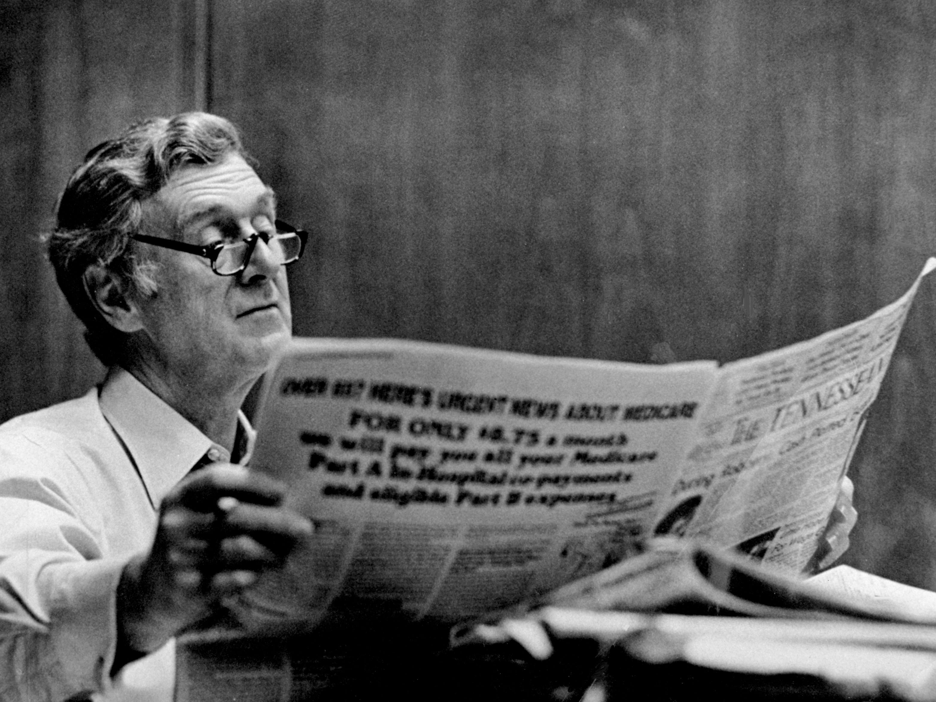 Tennessean Publisher John Seigenthaler reads over the day's paper May 13, 1982, in his office at 1100 Broadway.