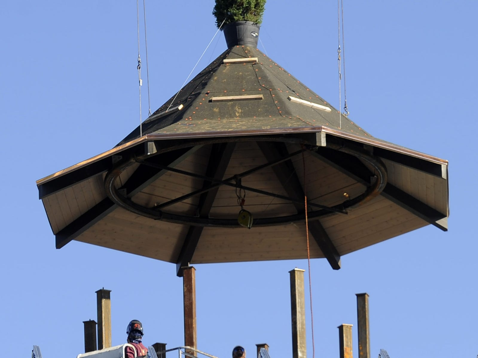 Workers install the roof of the Westminster bell tower on the new student center at Currey Ingram Academy Tuesday, Dec. 18, 2012.