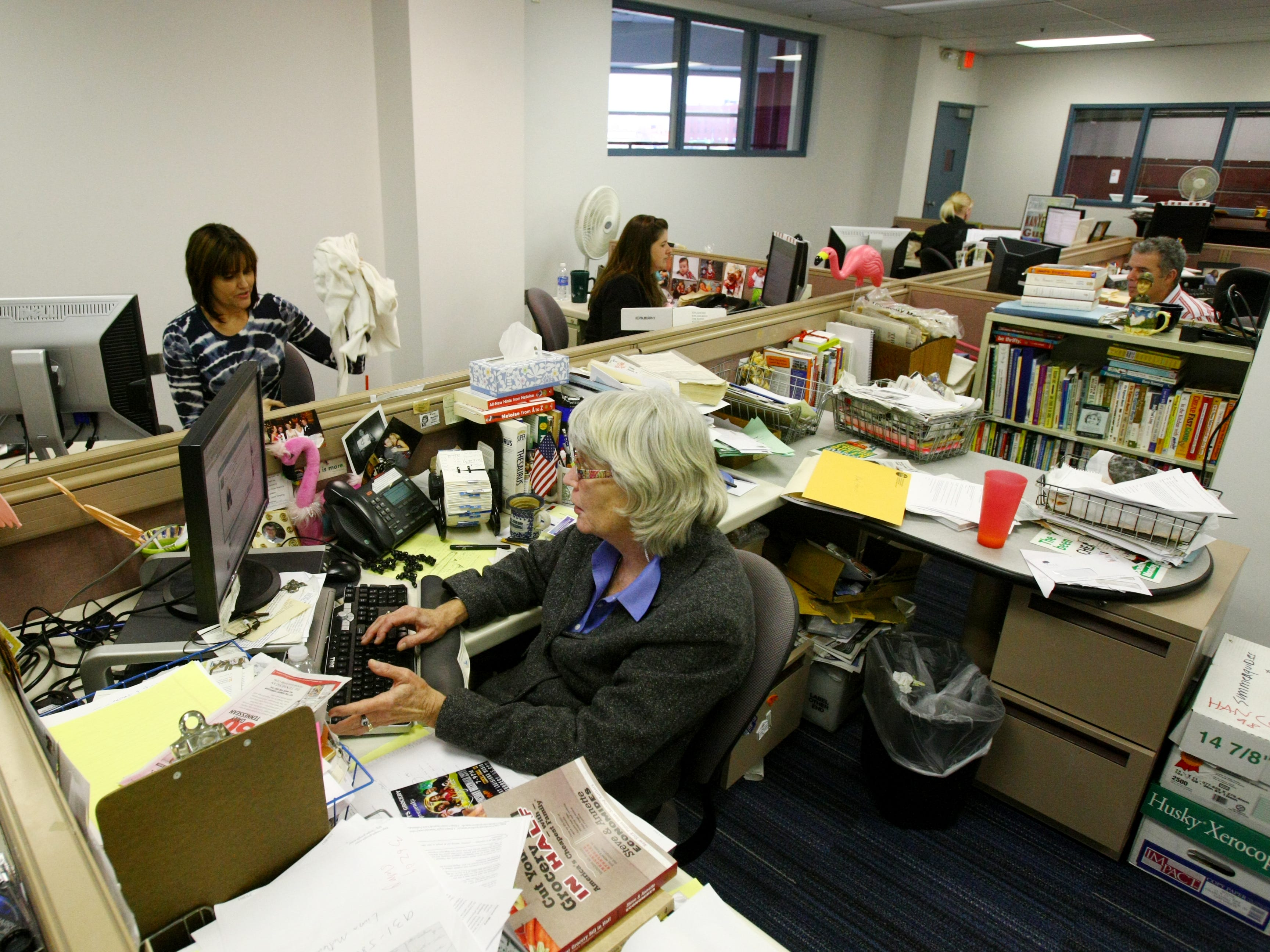 Tennessean staff members work on as the newsroom undergoes a renovation in 2010.