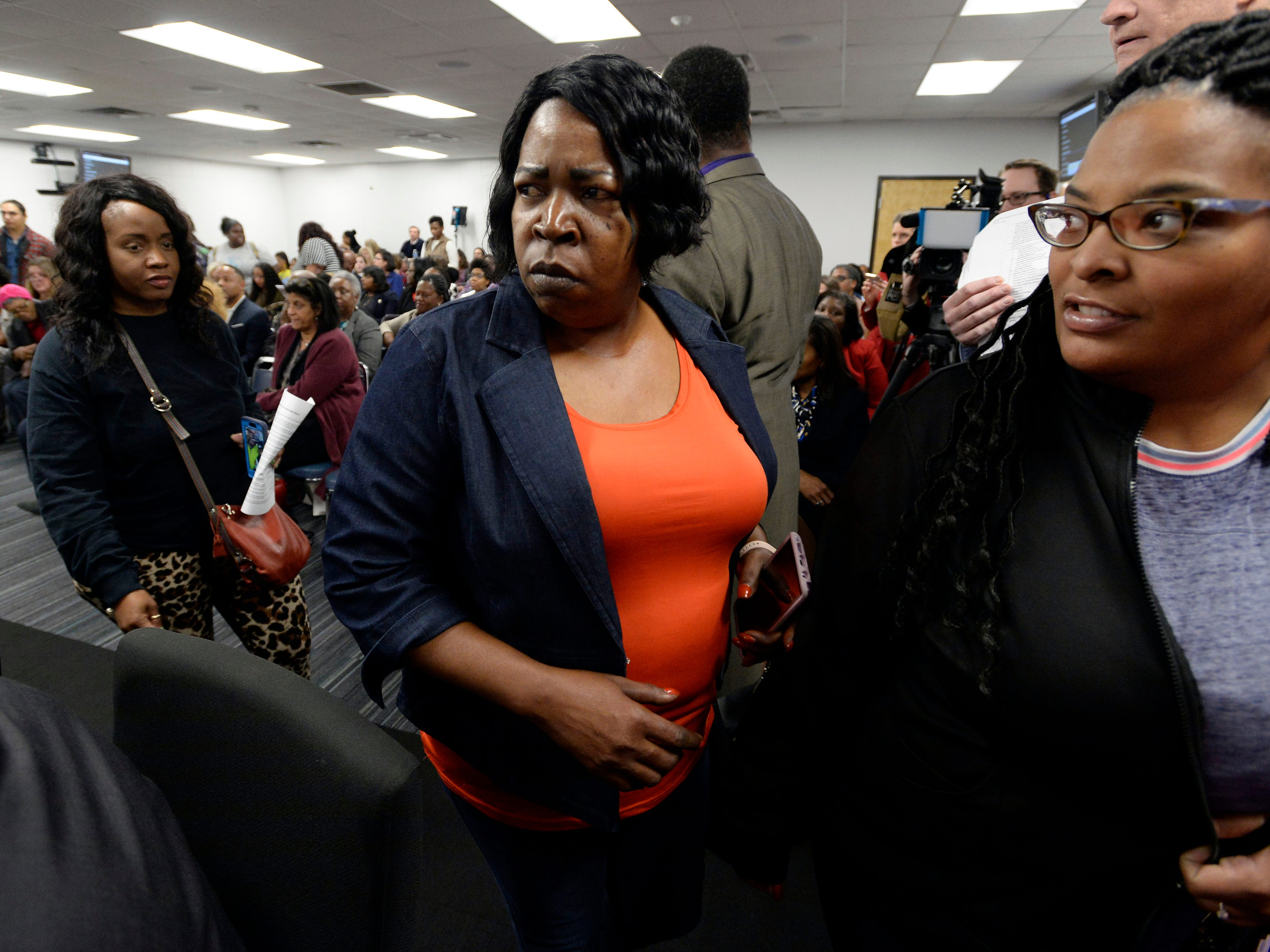 Parents walk out of the Metropolitan Nashville Public Board of Education board meeting on Tuesday, Jan. 8, 2019, in Nashville, Tenn., because they became angry when board members did not talk about the quality of education for their children.