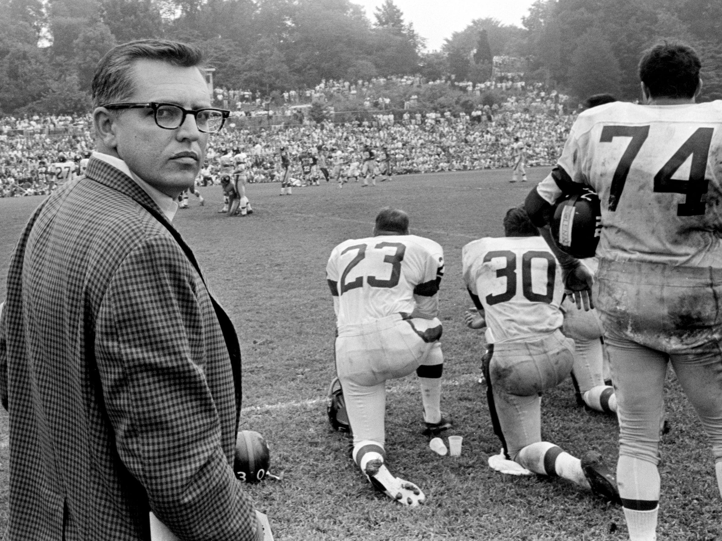 Tennessean sports reporter Jimmy Davy watches the New York Giants practice at their training camp in Fairfield, Conn., on Aug. 11, 1968.