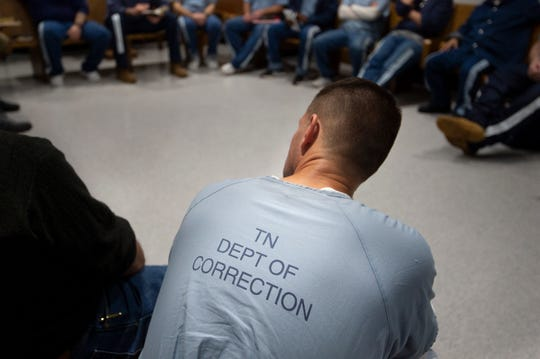 An inmate listens during a Men of Valor bible study at the Riverbend Maximum Security Institution.