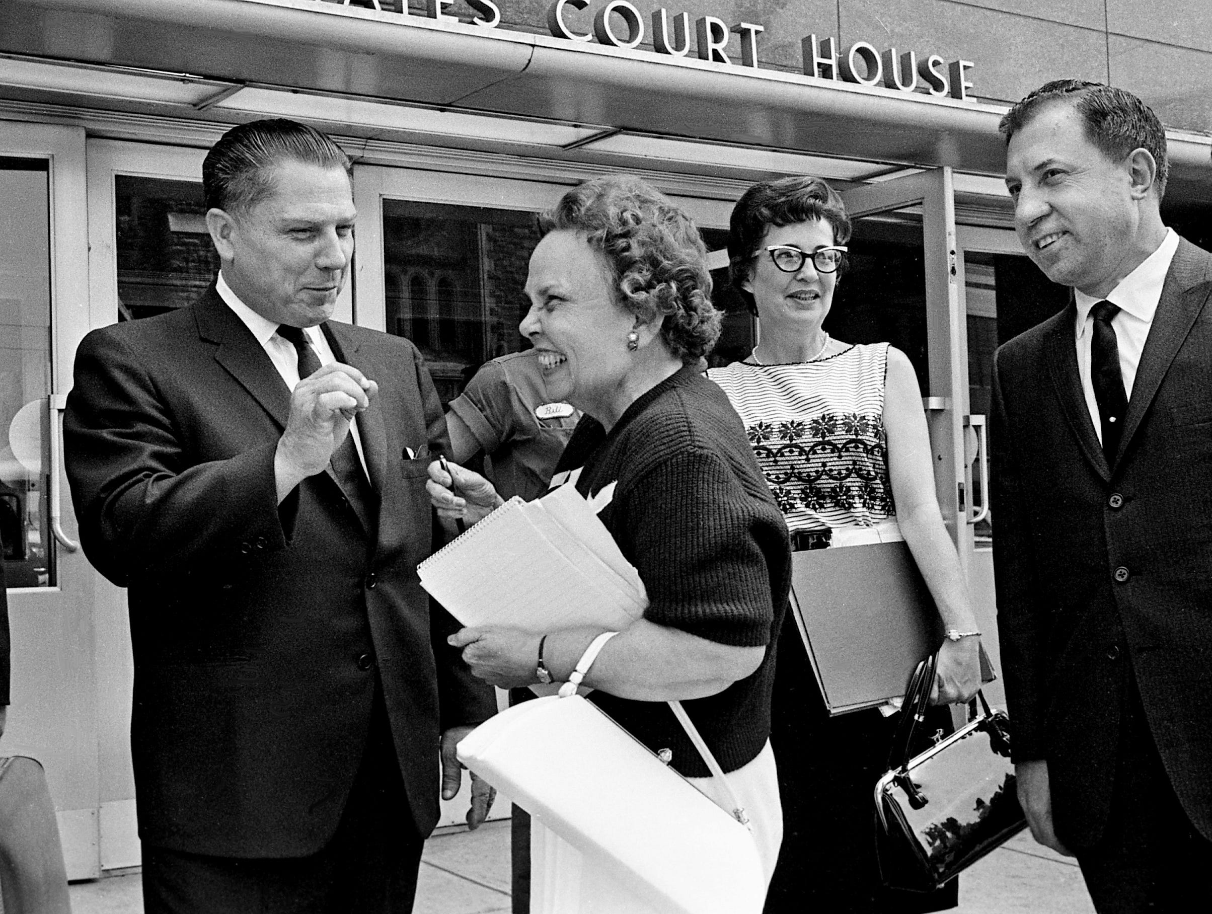 Teamsters President James Hoffa, left, answers a question from Tennessean reporter Nellie Kenyon in front of the federal courthouse in Nashville on July 22, 1963. Hoffa and six other defendants lost the first round in their fight for dismissal of a federal indictment charging them with jury tampering.