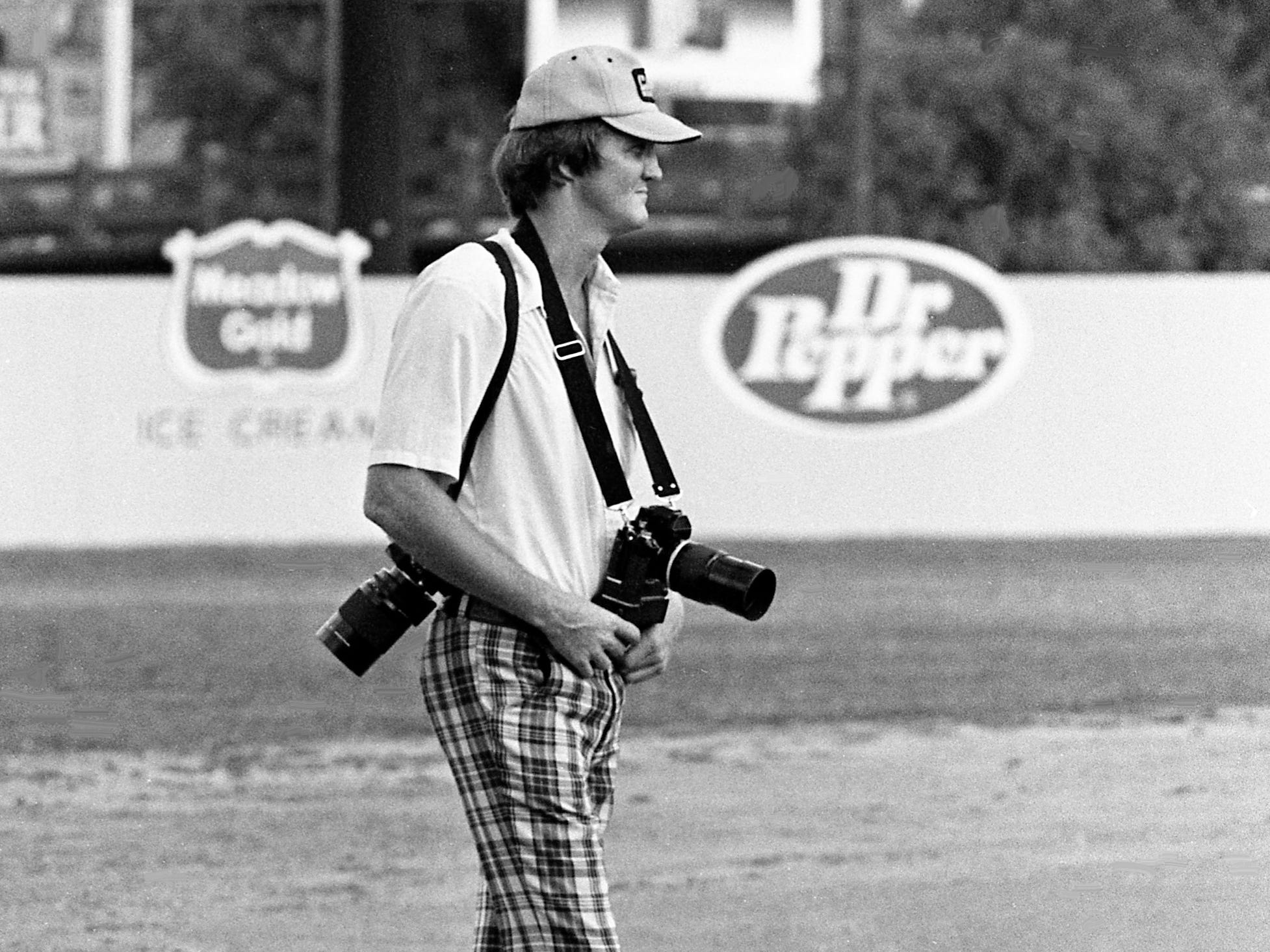 Tennessean staff photographer Dan Loftin is ready to cover the game between the Nashville Sounds and Memphis Chicks at Greer Stadium on July 11, 1978.