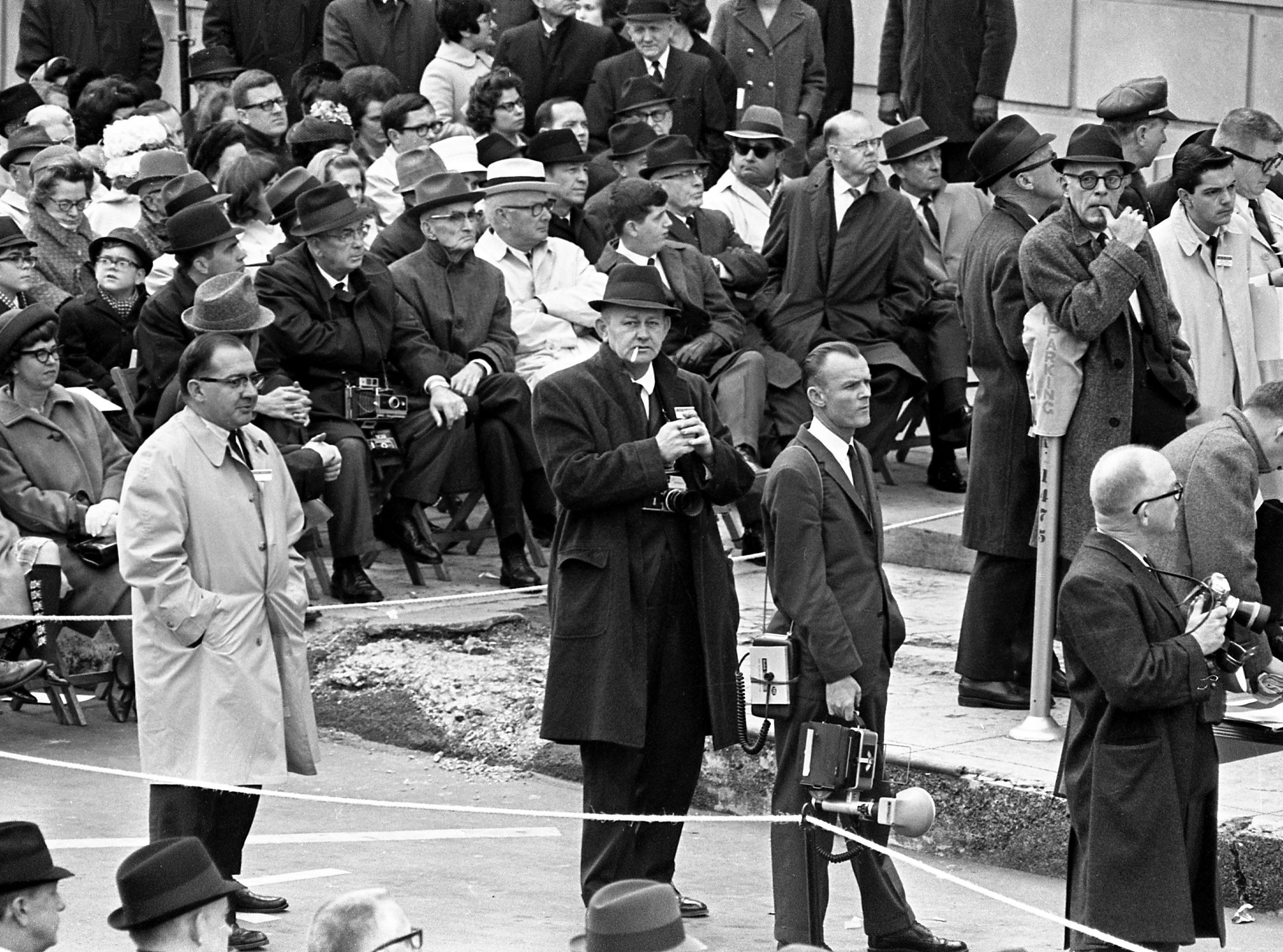 Tennessean chief photographer Bill Preston, center, covers the inaugural ceremony of Gov. Buford Ellington in downtown Nashville on Jan. 16, 1967.