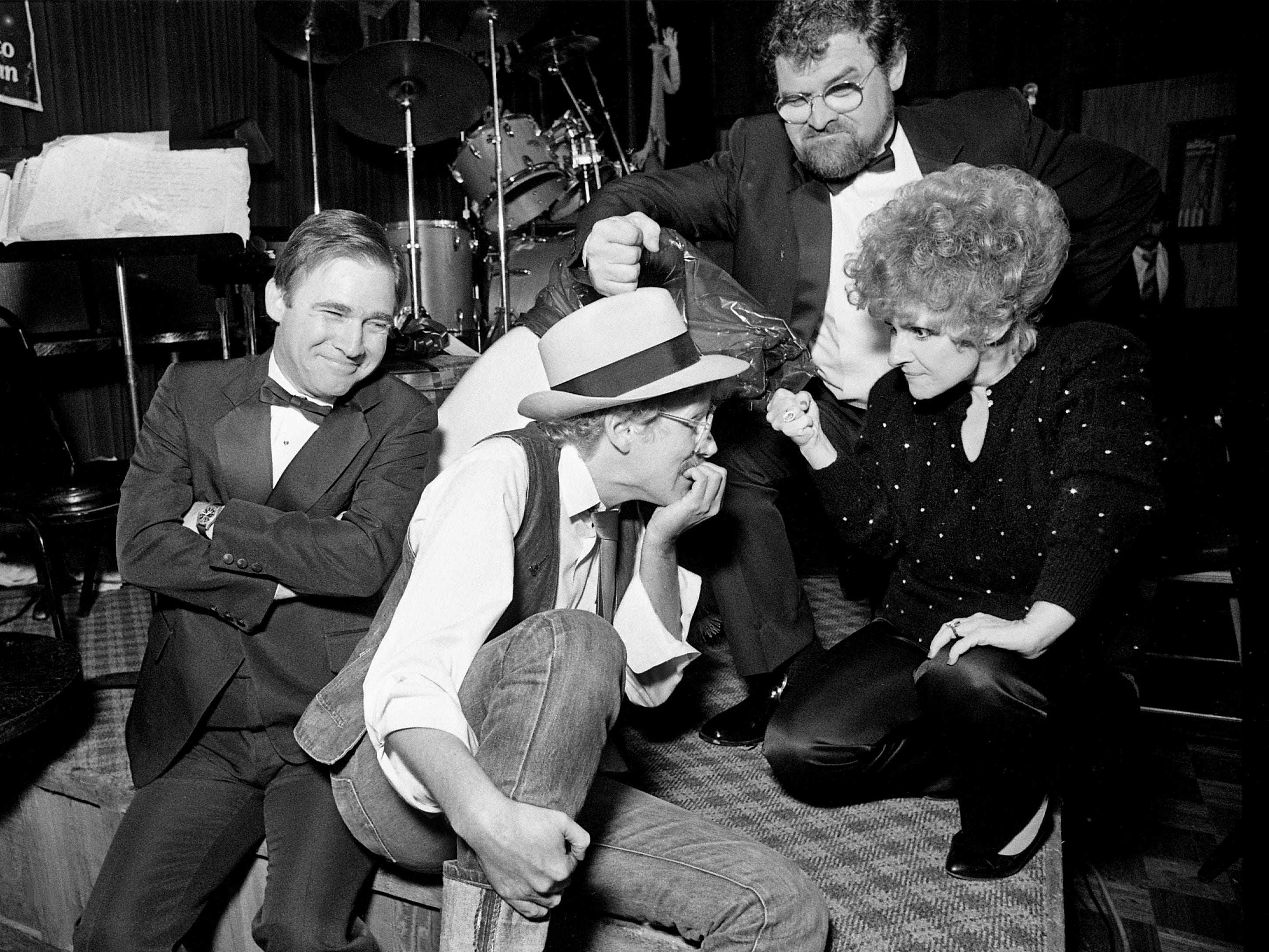 "Tennessean music reporter Bob Oermann, second from left, fends off an onslaught from comedy team Sandy Pinkard, left, and Richard Bowden along with country-pop great Brenda Lee on Oct. 29, 1985. Pinkard and Bowden were masters of ceremonies for the ""Tacky Roast"" of Oermann at the Nashville Palace to benefit a journalism scholarship fund."
