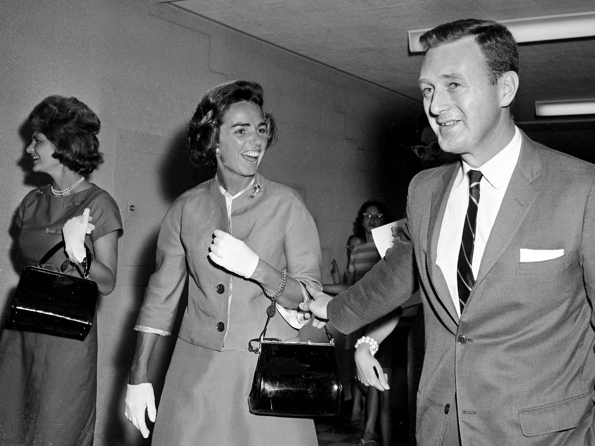 Ethel Kennedy, center, the wife of U.S. Attorney General Robert F. Kennedy, shares a moment with Tennessean editor John Seigenthaler after arriving at Berry Field on May 27, 1962, during a stopover en route to Cullman, Ala., to deliver a commencement address to the all-male graduating class at St. Bernard College.