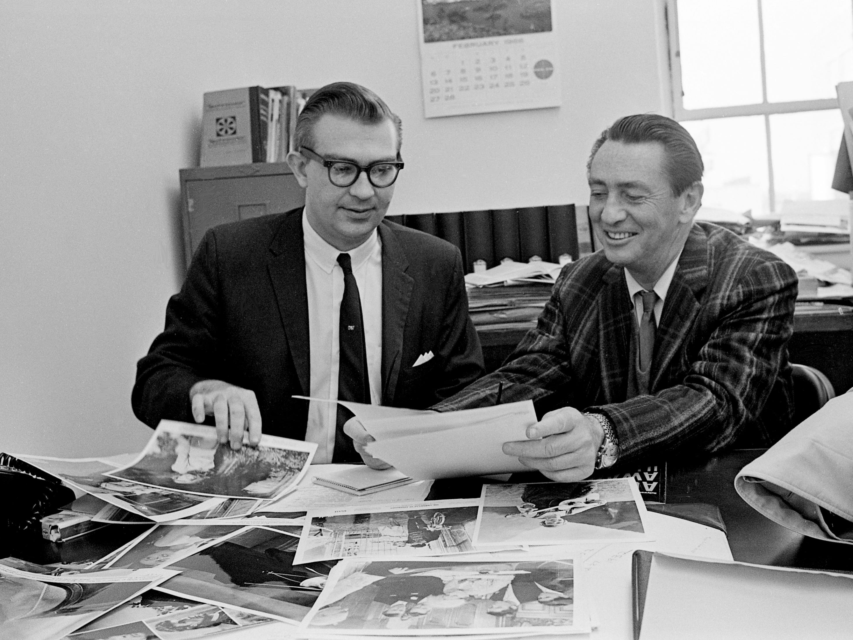 "Actor MacDonald Carey, right, an official for the Academy of Motion Picture Arts and Sciences, reviews this year's Oscar nominees with Tennessean movie editor Harry Haun at the paper's office at 1100 Broadway on Feb. 25, 1966. Carey was visiting Nashville to promote his new daytime TV serial, ""Days of Our Lives."""