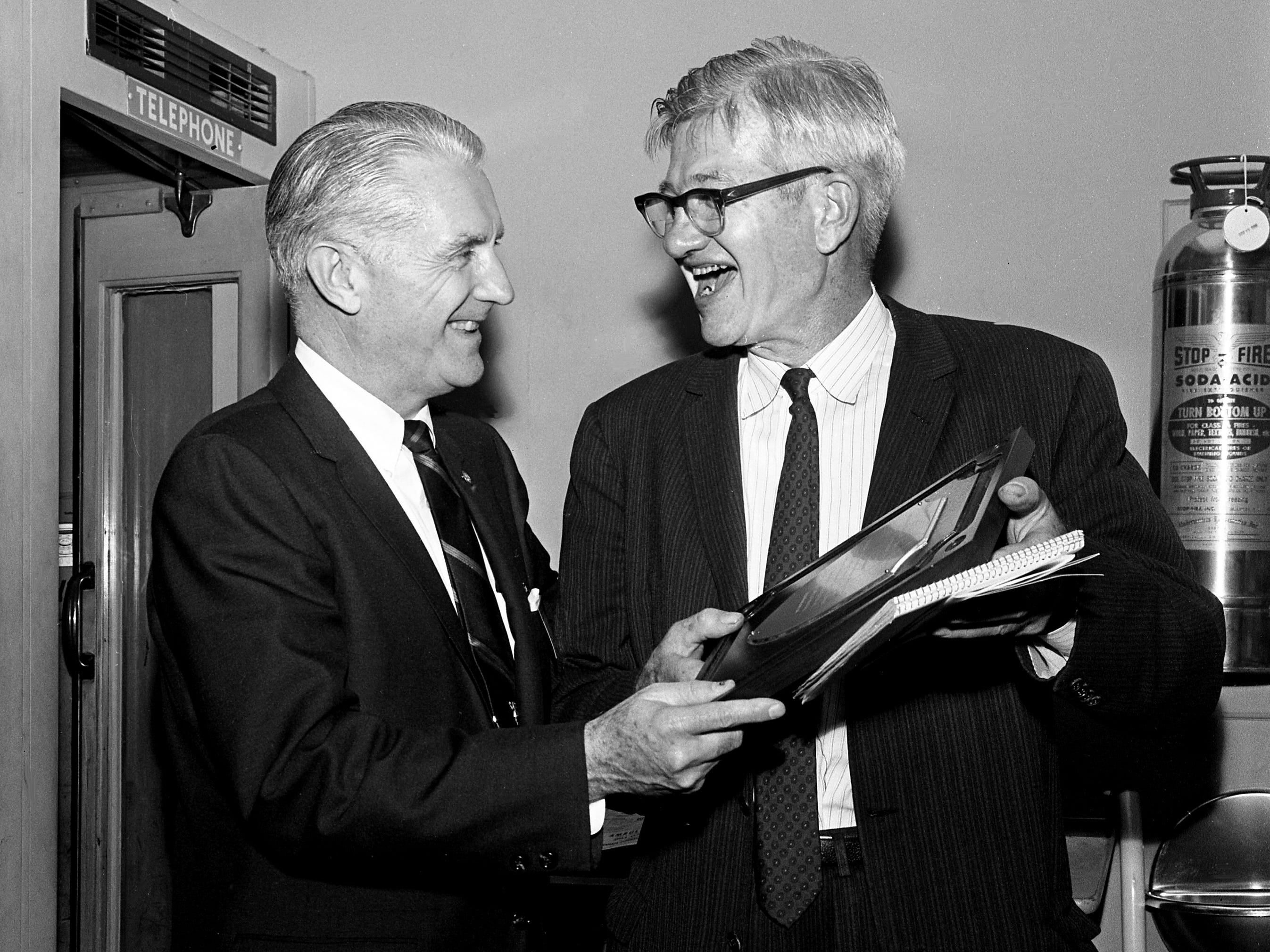 Nat Caldwell, right, Pulitzer Prize-winning reporter for The Tennessean, gets a plaque Oct. 25, 1966, from the president of the state rural cooperatives association, Paul Tidwell, for years of covering issues in rural Tennessee.