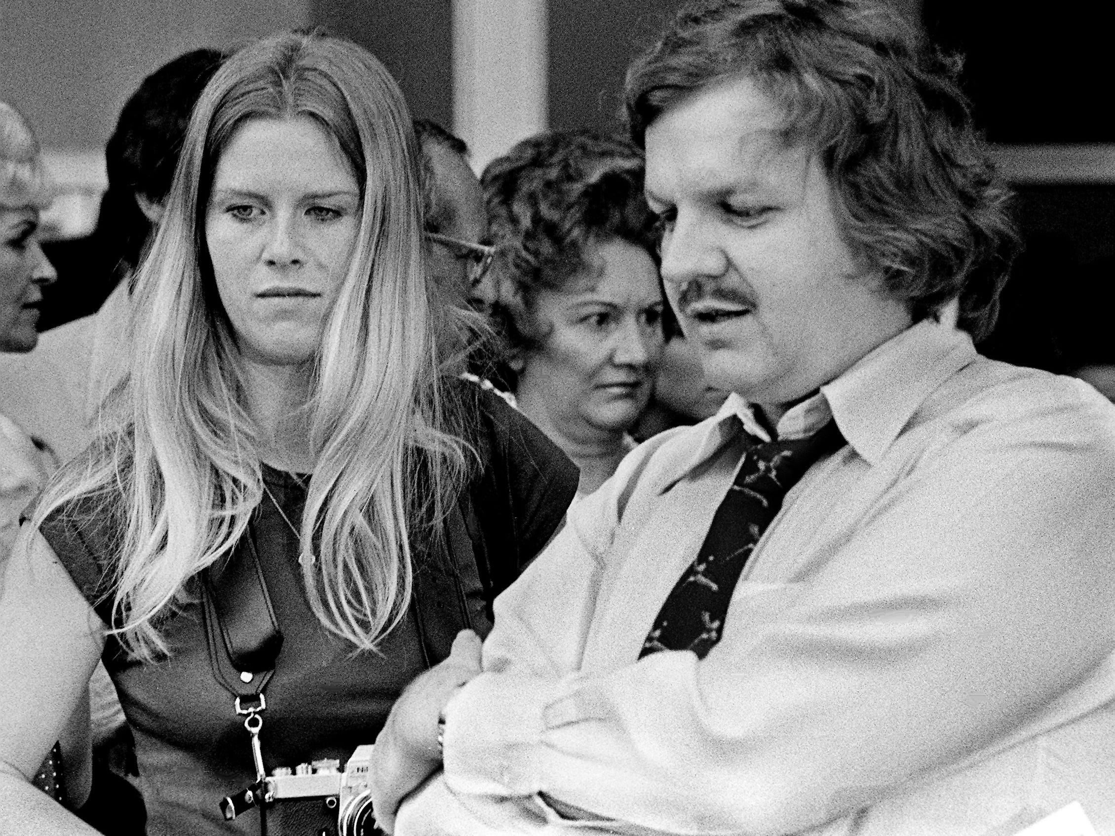 "Freelance photographer Tipper Gore, left, and Kirk Loggins, reporter for The Tennessean, wait on the stars arriving for the premiere showing of the movie ""Nashville"" at the Martin 100 Oaks Theater on Aug. 8, 1975."