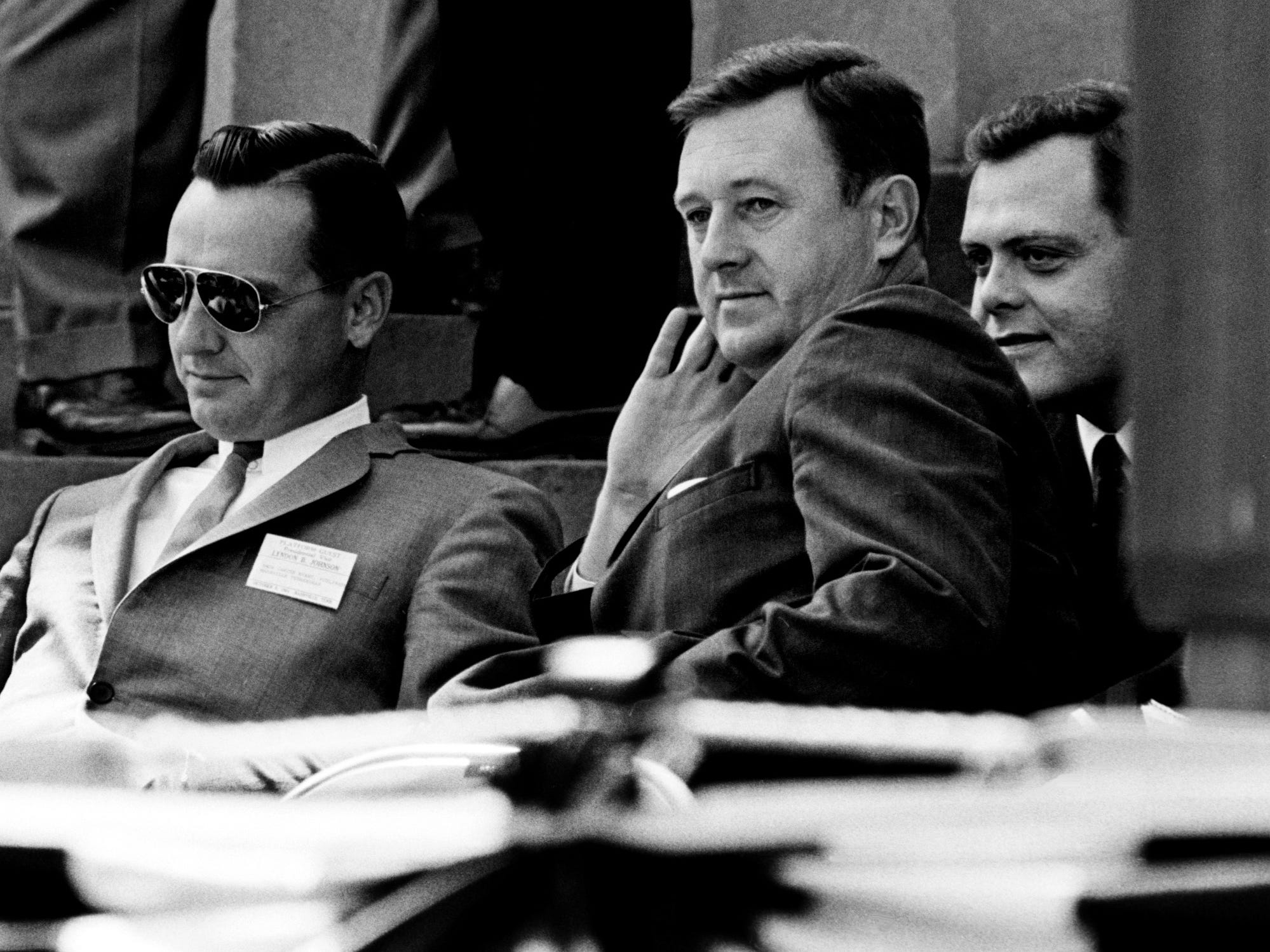 Amon Carter Evans, left, publisher, and John Seigenthaler, editor of The Tennessean, wait for President Lyndon B. Johnson's campaign speech at Memorial Square on Oct. 9, 1964.
